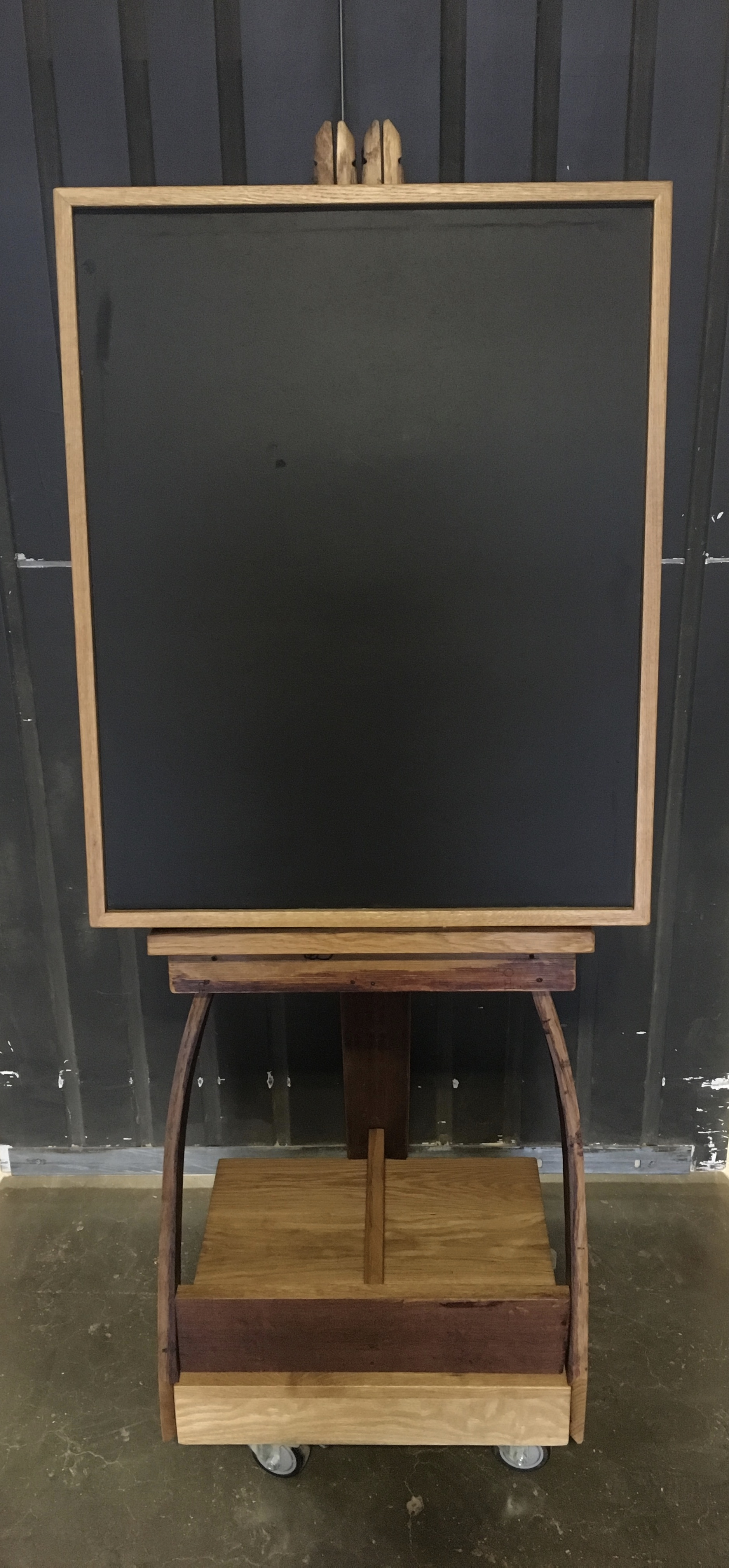 Barrel stave easel and chalkboard on mobile base