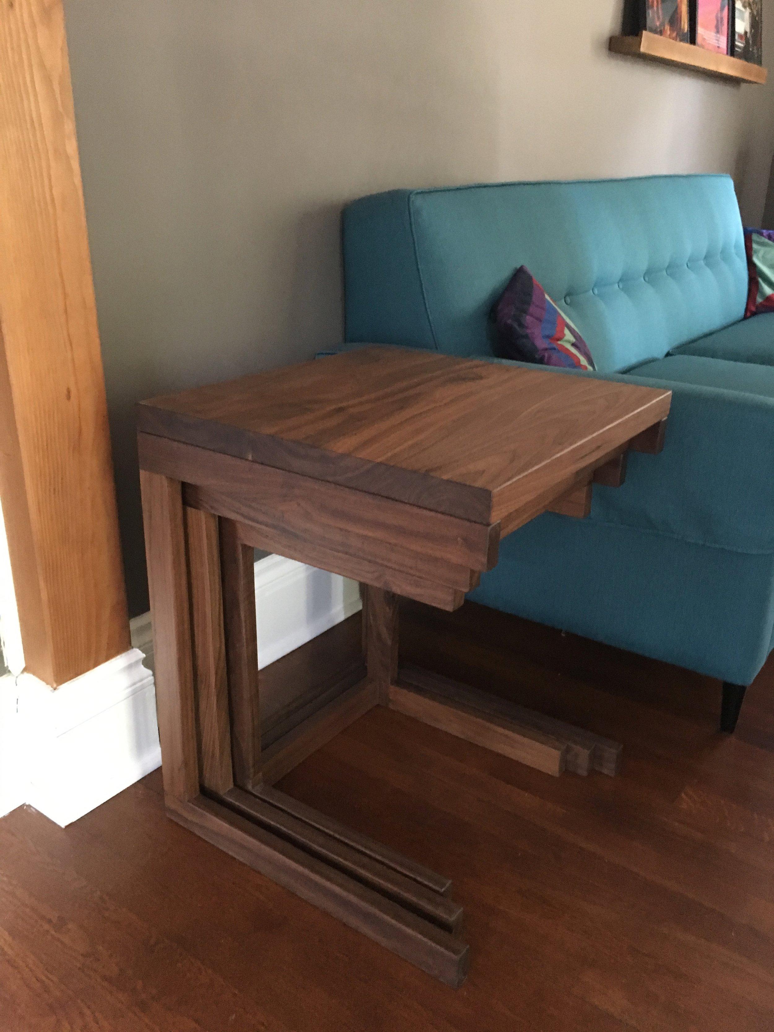 Walnut nesting tables stacked