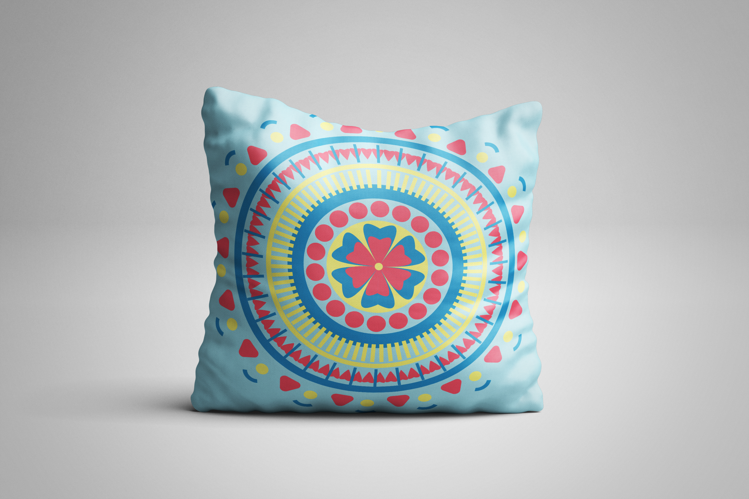Mandala Pillow Blue red yellow.png