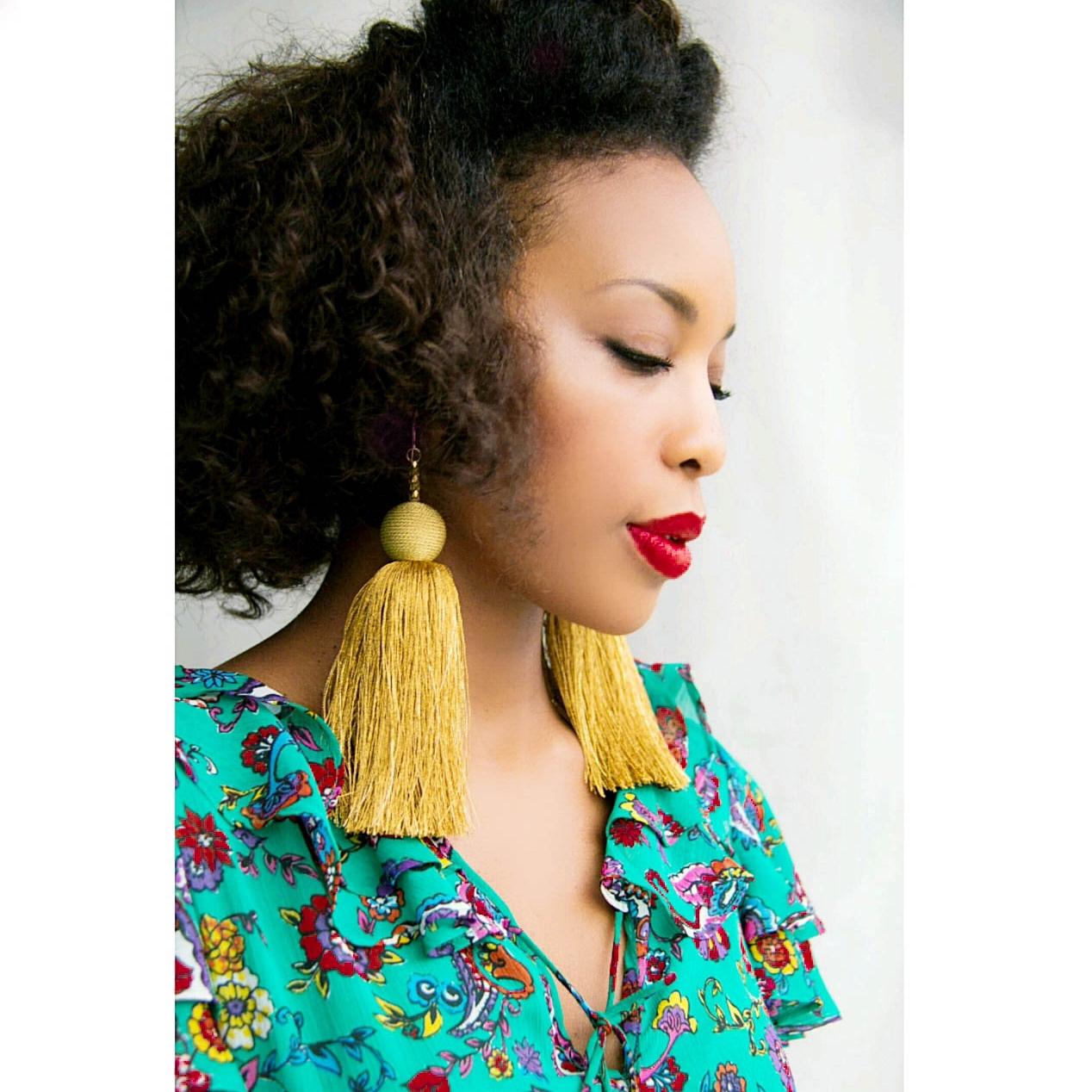 LaToya feels strongest when she is wearing statement earrings and lipstick