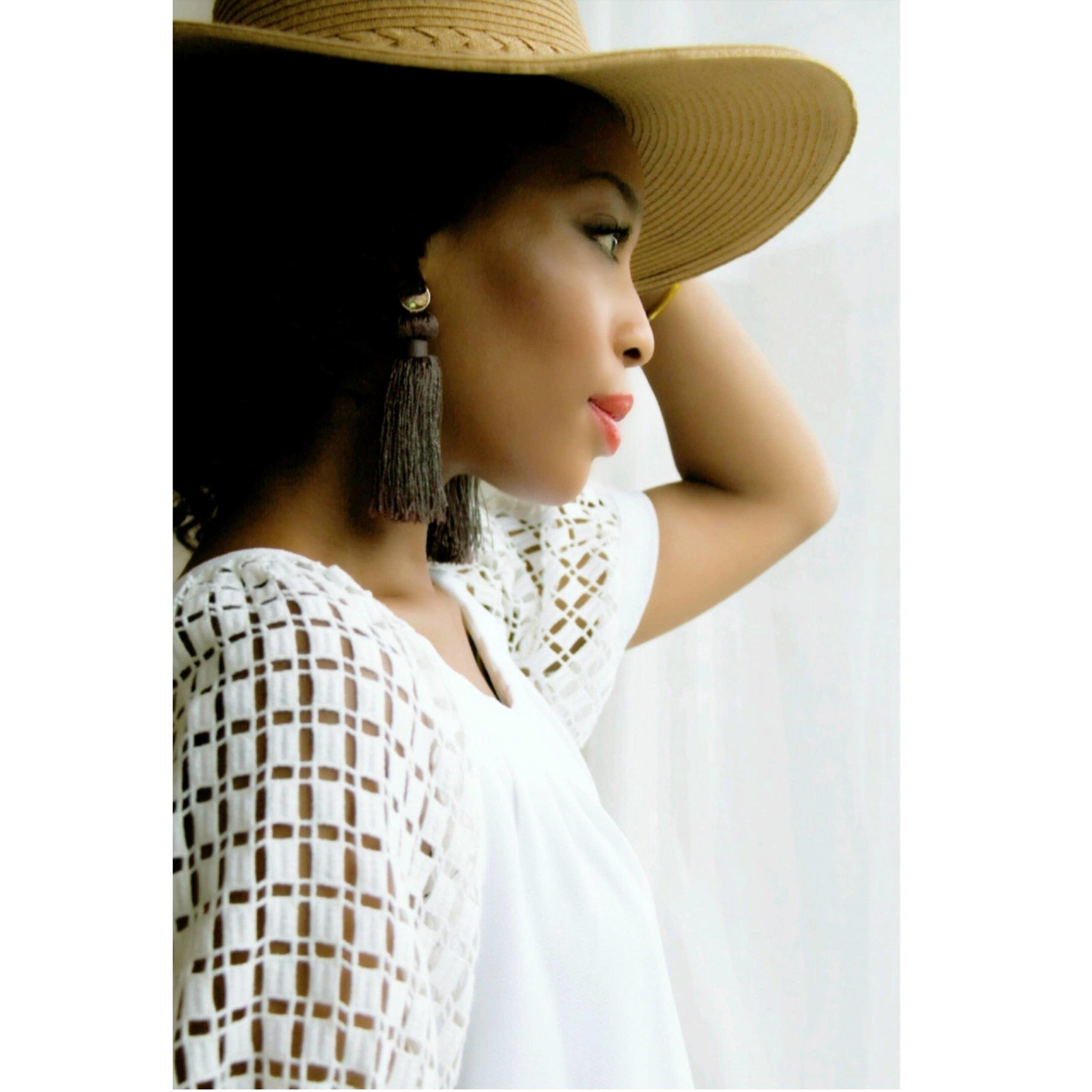 LaToya wearing the first piece of jewelry she created