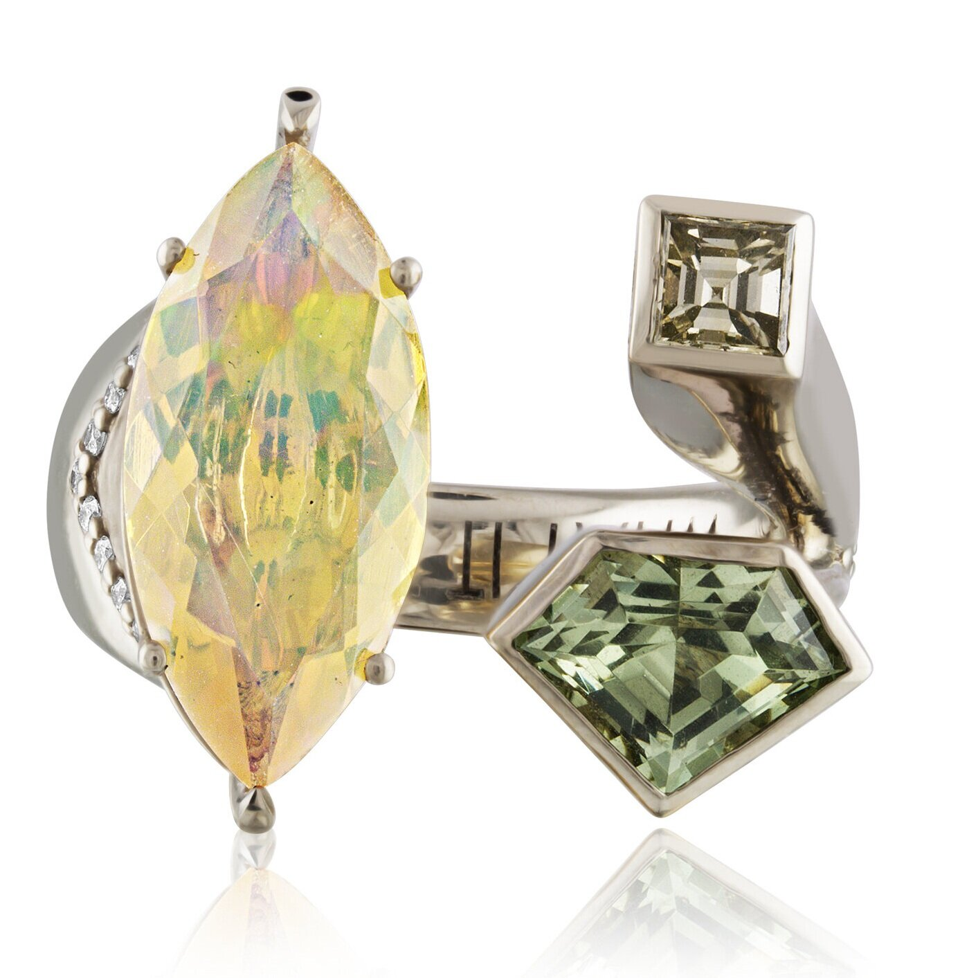 Julie's power ring: her WHAT IT TAKES RING designed for AGTA's Spectrum Awards 2019. Opal for fire and passion, Diamonds for strength, Green Garnet shield protects finances and stimulates growth.