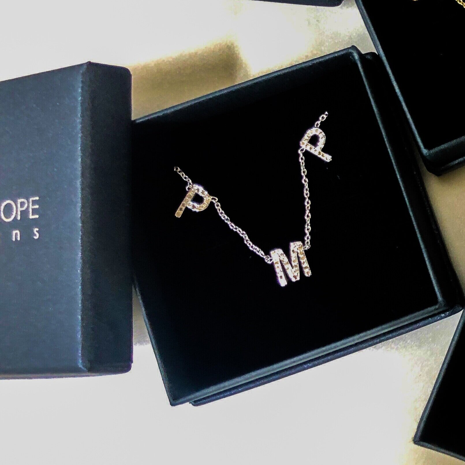 The best gift Kara has given recently: One of her initial necklaces to her friend Paige