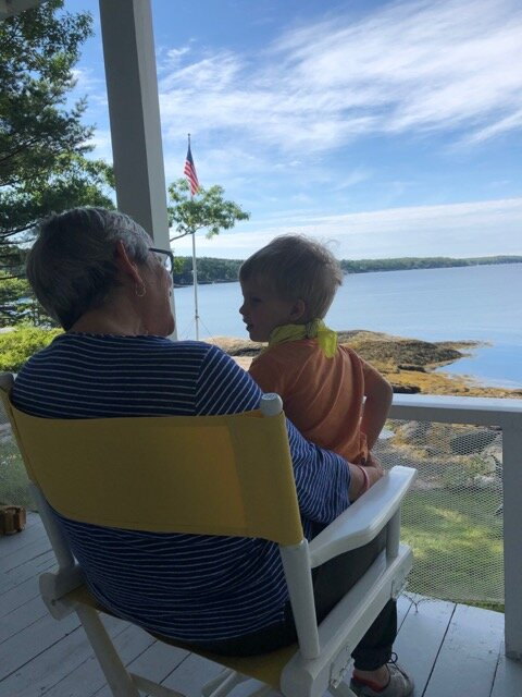 Photo on the porch of Robin with my grandson