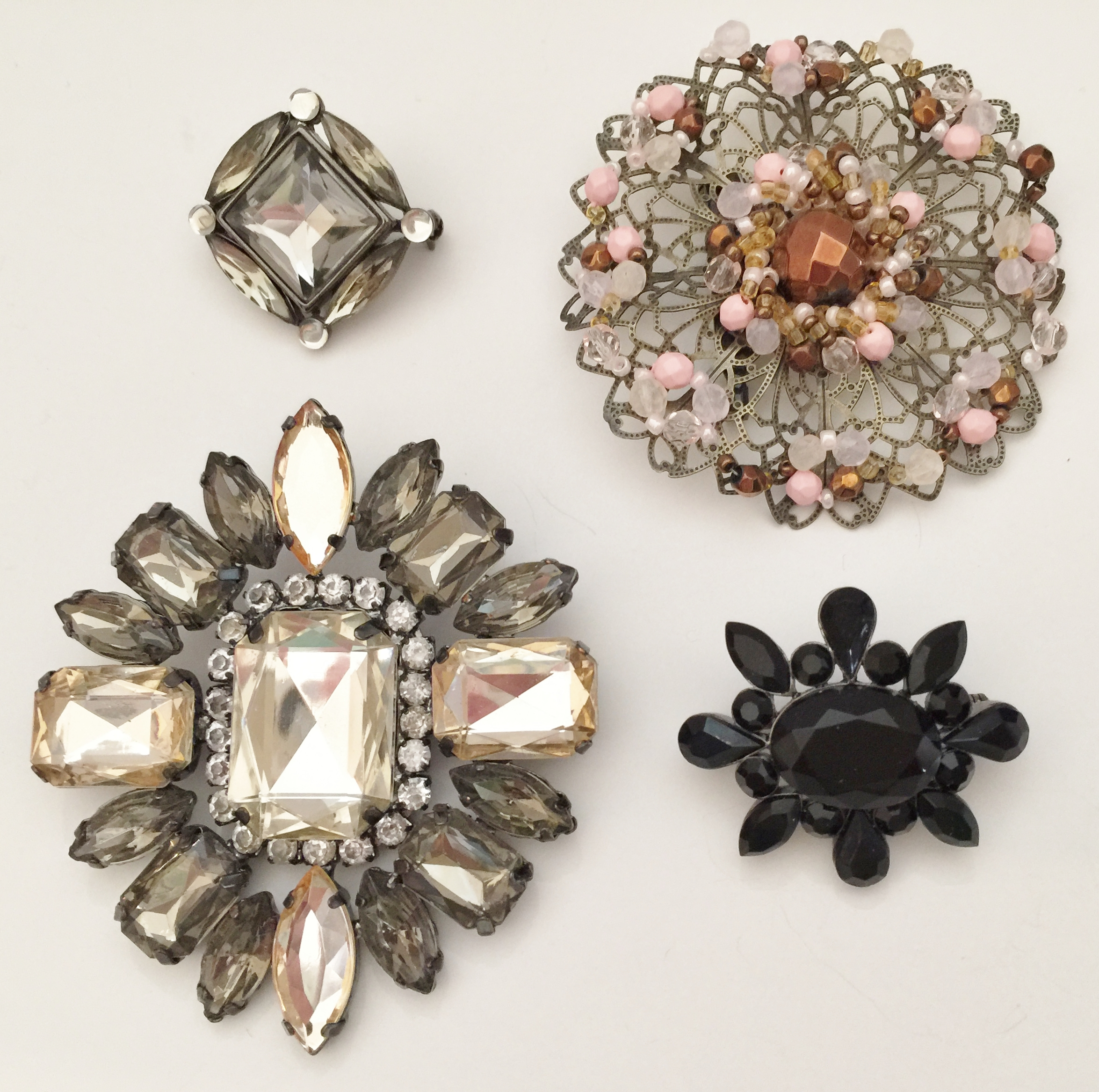 Modern-day Jeweled pins.  The two small pins are Liz Claiborne.
