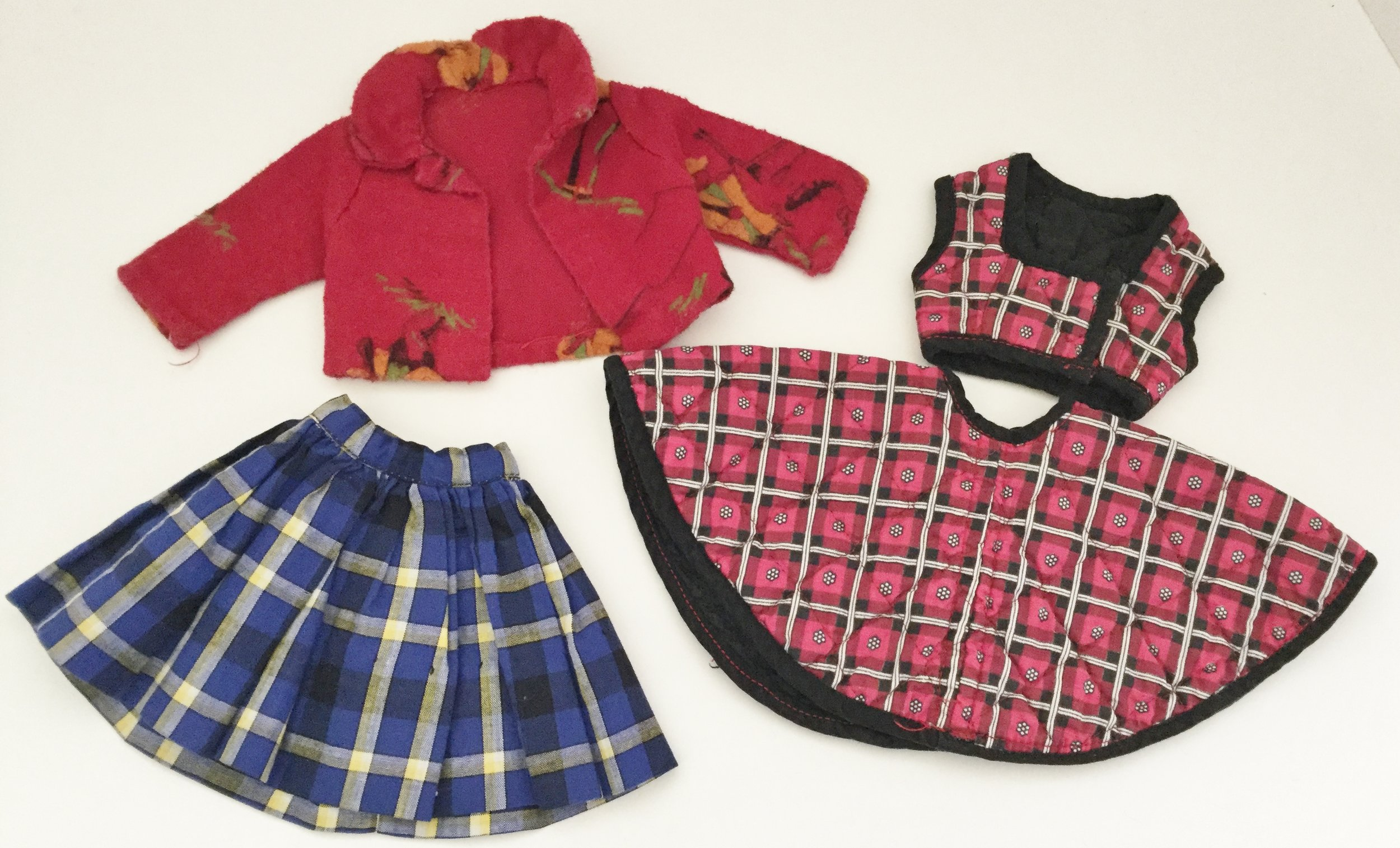 Circular skirt with weskit and blue plaid skirt were to be worn with her original white shirt and bow tie.  A red flannel shirt to wear with jeans.
