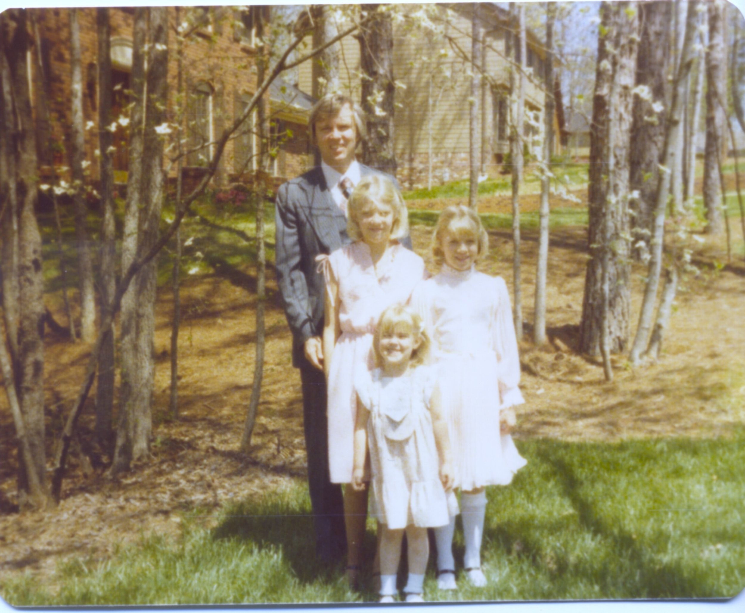 Our three daughters Lisa, Laurie, and Debra with their dad ... Hearthstone Circle, Easter 1979