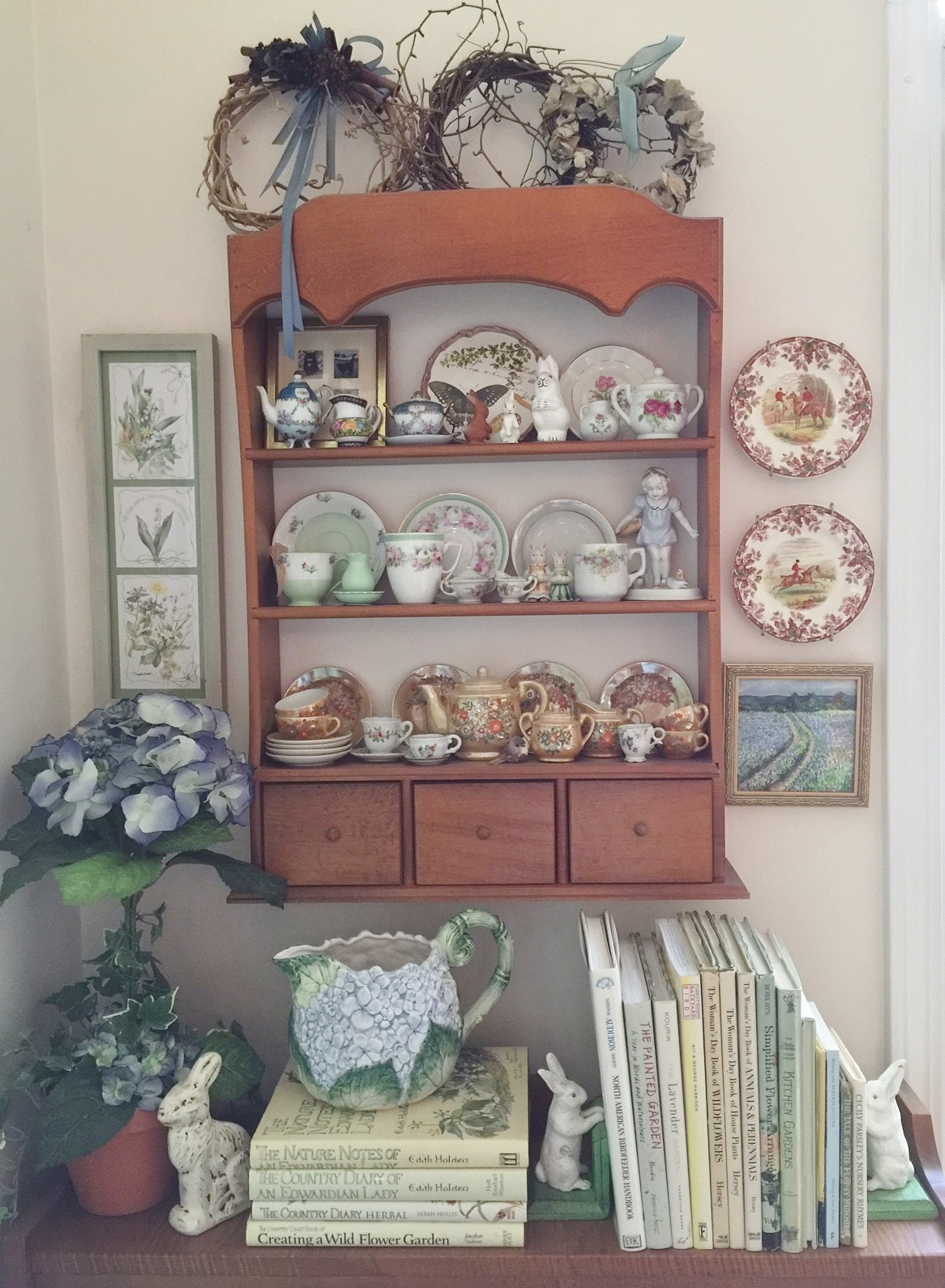 Home to some of my bunnies ... three little bunnies on the top shelf ... china bunny couple on the second shelf ... bunny figurine on top of the bookshelf ... and such a cute pair of bunny bookends holding up gardening and Beatrix Potter books