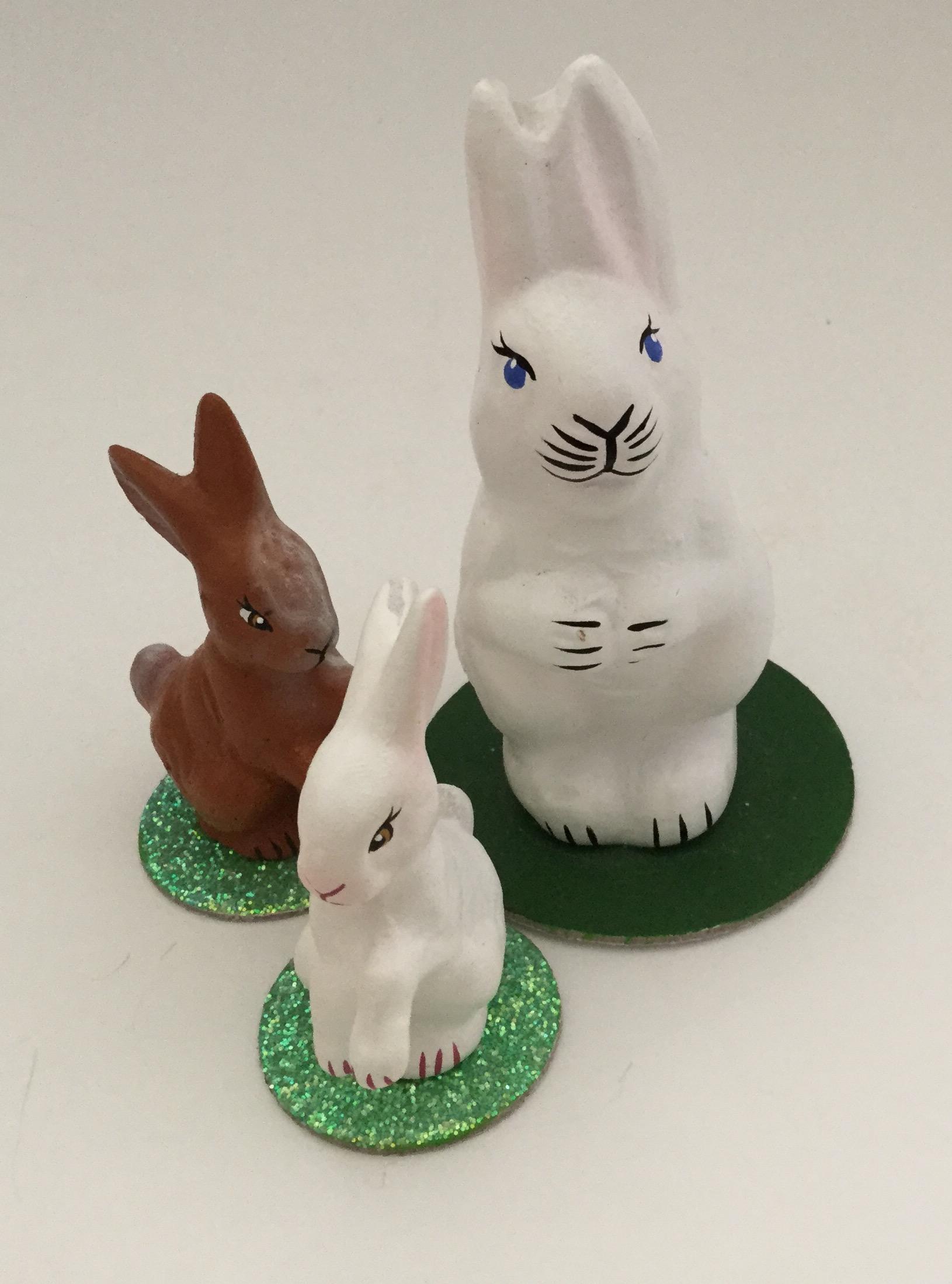 Three little chalk-ware bunnies
