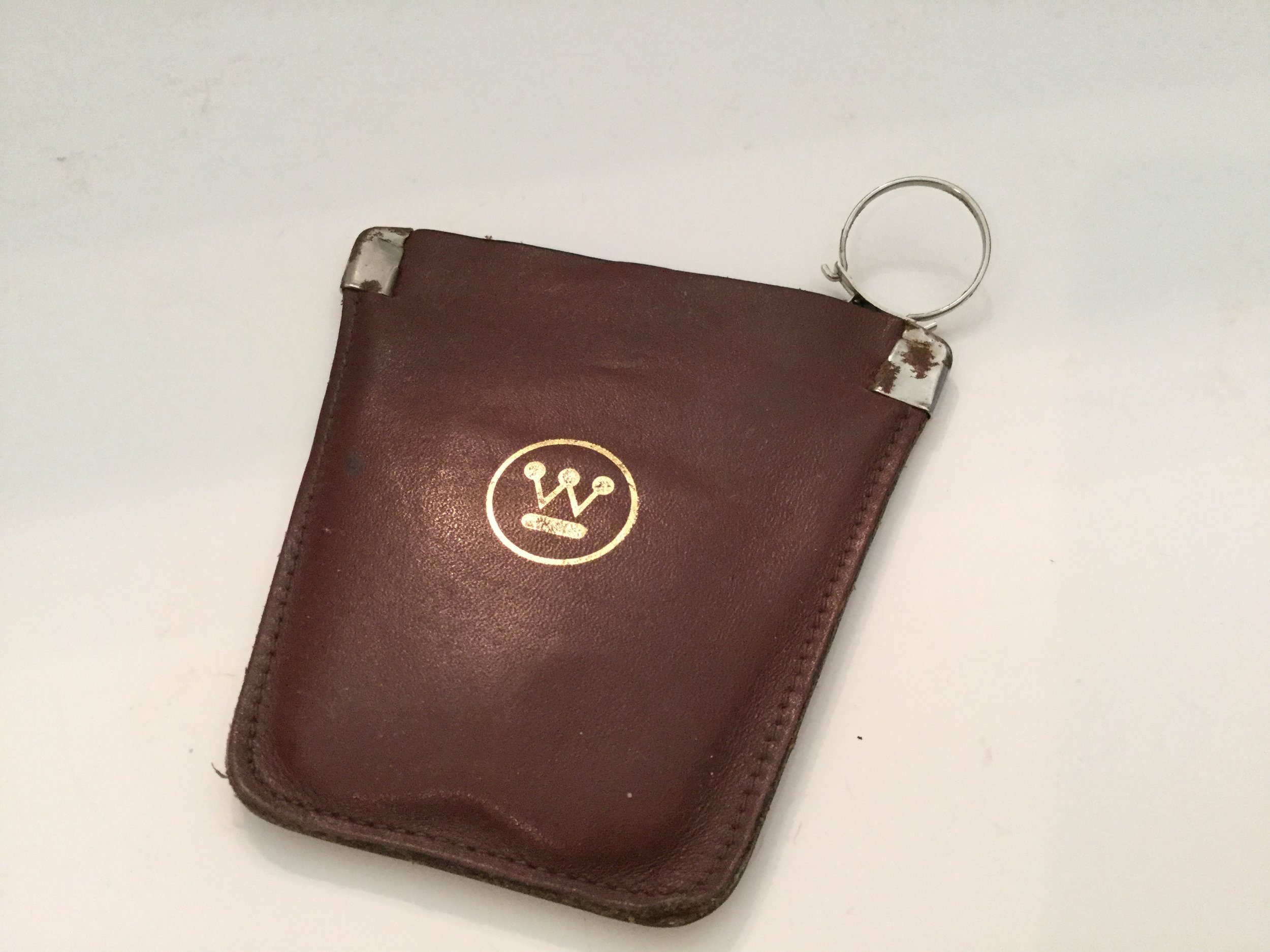 A leather change purse and key chain that I collected