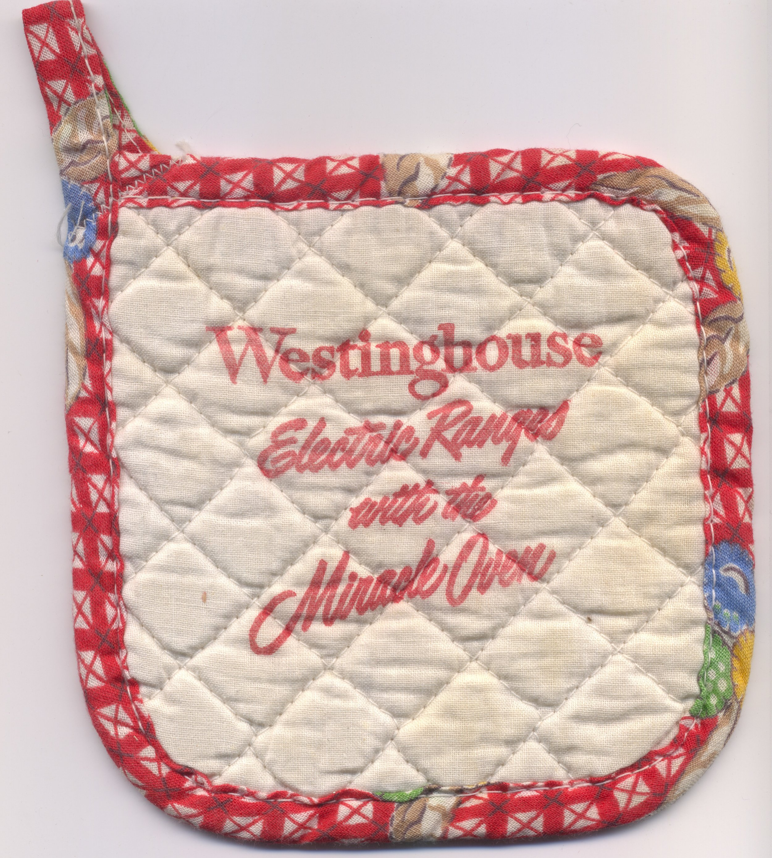 A fun collectible pot holder that no doubt came with a new Westinghouse electric range