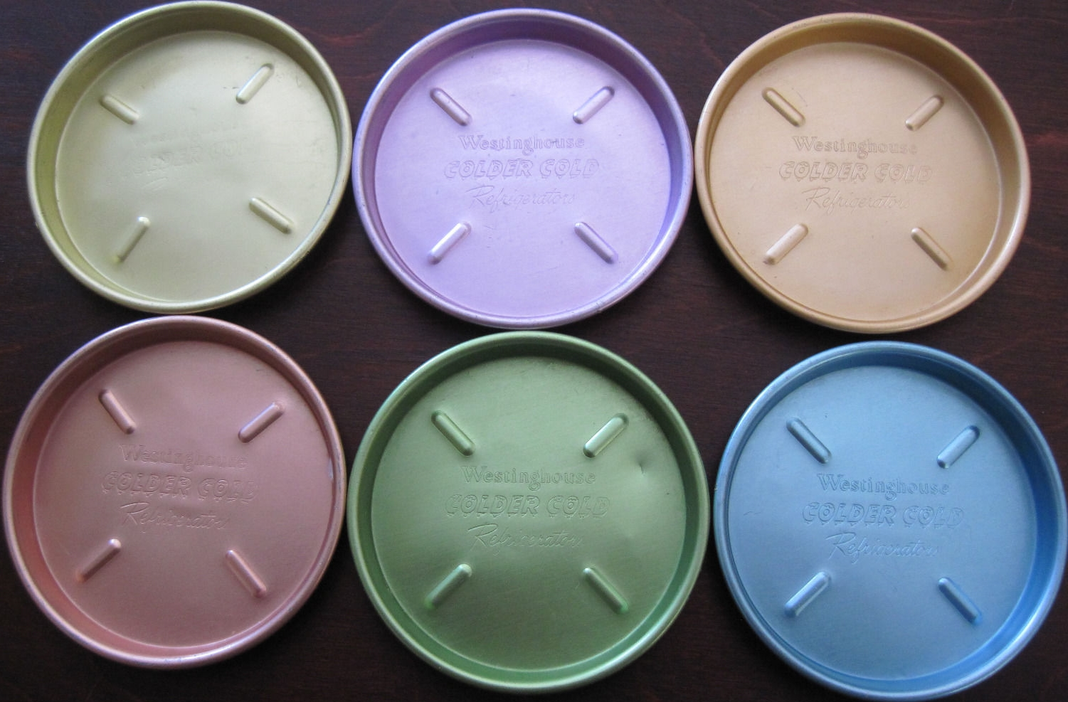 A colorful set of aluminum Westinghouse coasters that evidently came with a new refrigerator. Almost everyone had a set of tall skinny aluminum drink glasses in the 1950s.