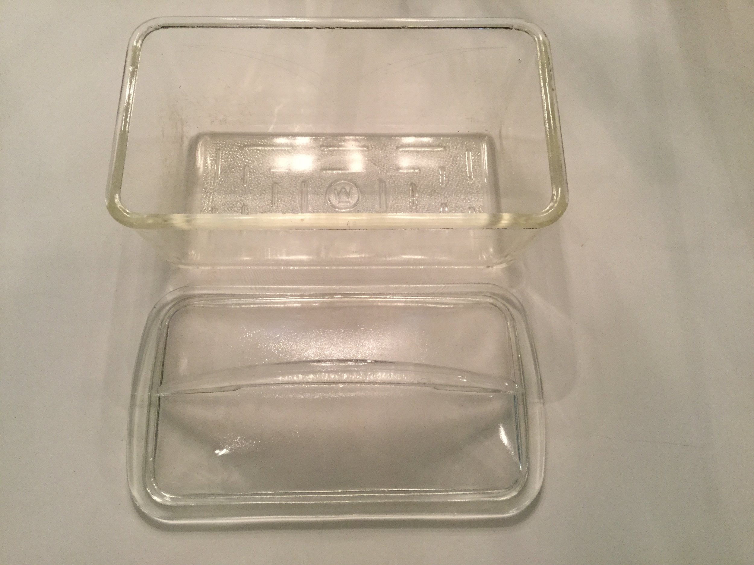 The Westinghouse logo on the glass loaf dish ... there is a small logo on the handle of the lid