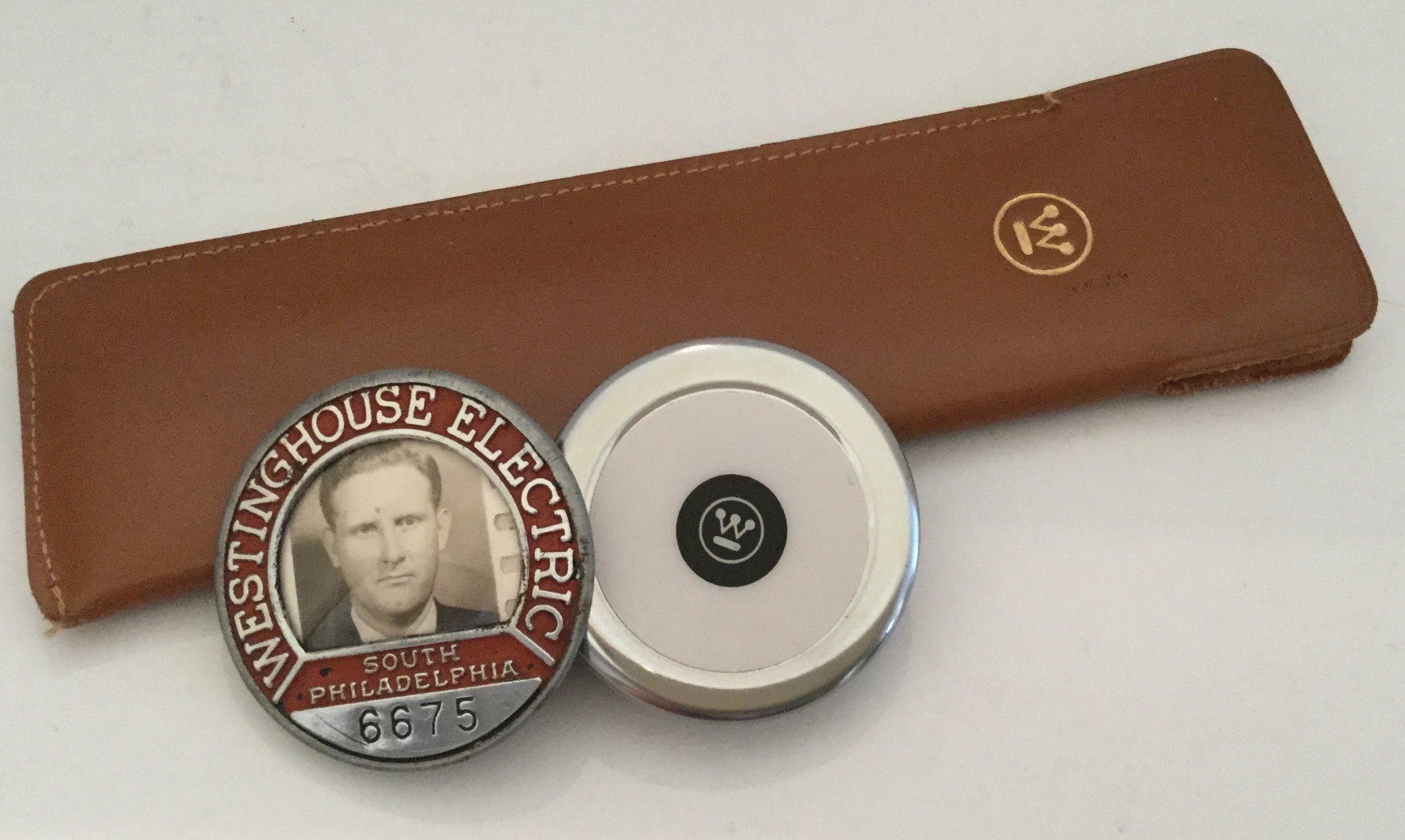 Slide rule, tape measure, and employee badge belonging to my dad