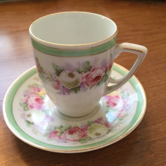German pink and green demitasse cup and saucer