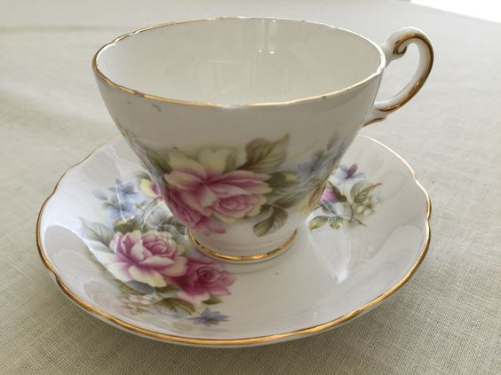 Pink roses cup and saucer ... Regency bone china made in England