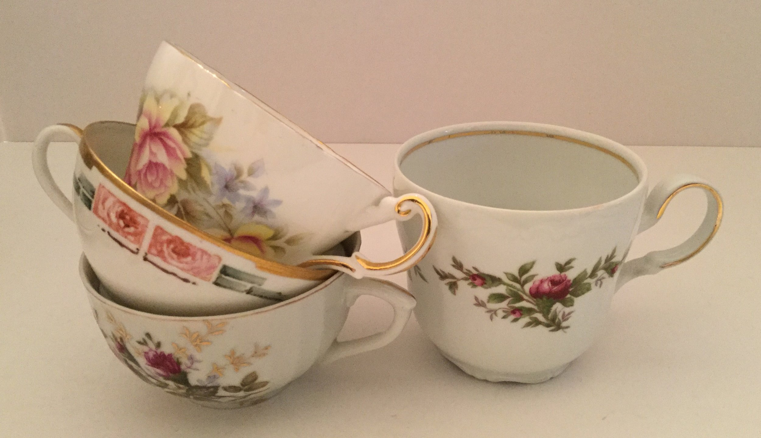 Orphan cups ... large cup on the right is Traditions Fine China by Johann Haviland China Corporation
