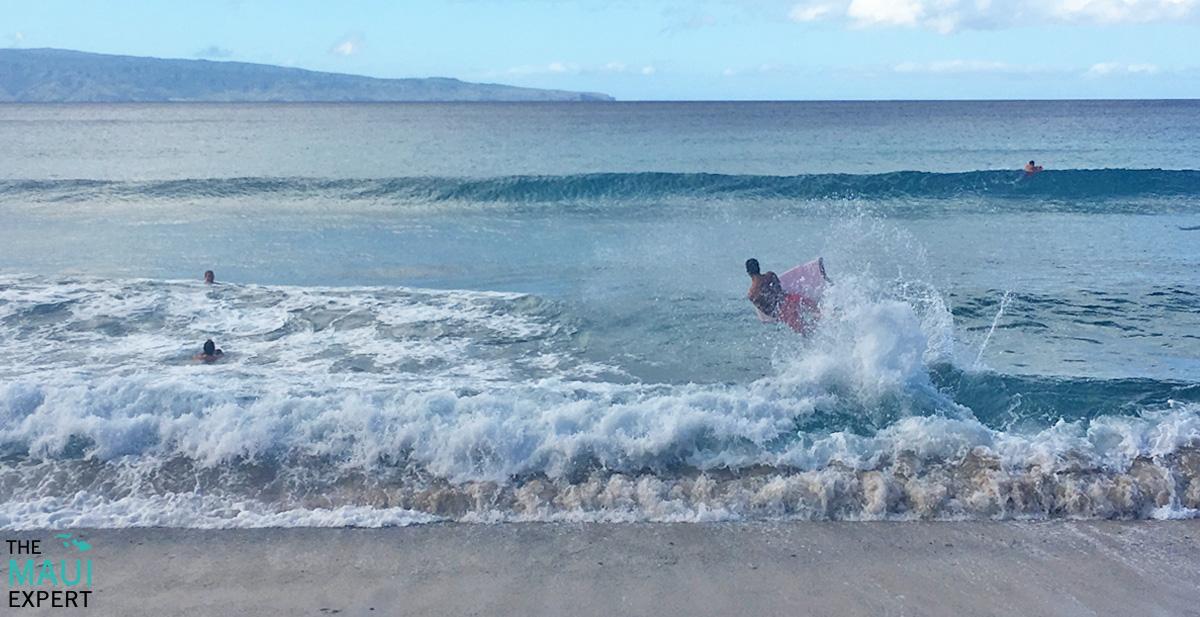 Boogie boarding DT Fleming Beach Park Maui