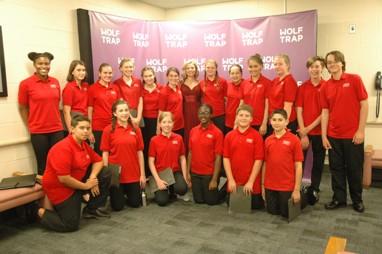 Choristers pose with soprano soloist Amy Owens