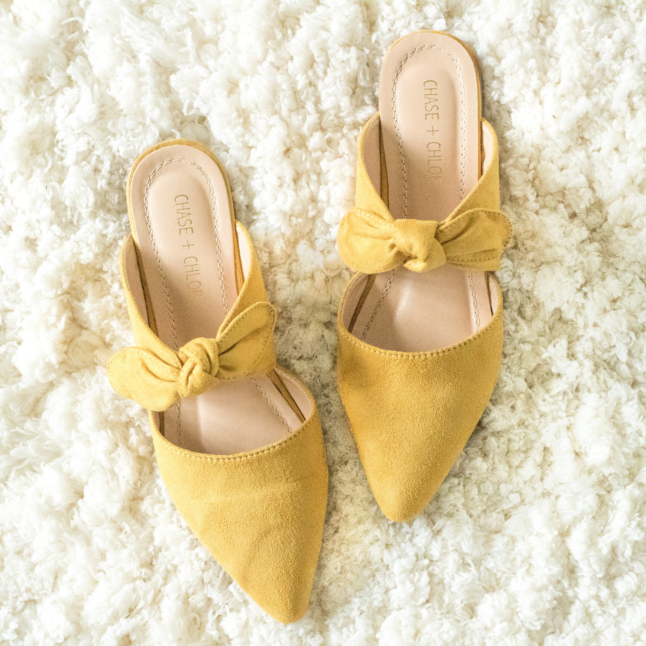 Yellow Bow Mules - I've gotten several pairs of shoes between the pink espadrilles above and these yellow bow mules, but I skipped ahead to reviewing these because I'm afraid they'll sell out! They are only $21 (and I have a 15% off coupon code for them: DEMURE15). So, they are just under $18, and are sold at one of my favorite online boutiques, Revie. They run a little small, so make sure you size up a half size! They are a soft suede material, the yellow is so fun, the leather isn't rigid, and the bow/pointy-toed combo is so perfect!! The soles are a little thin (I mean, they're only $18), but were still perfectly fine for all day wear. No break-in period. A wonderful purchase for the price!!! And a great way to support small business :)