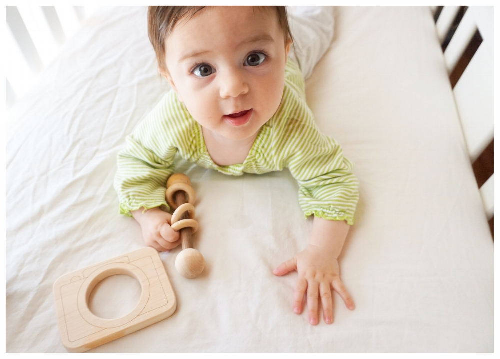 Shop for all things wood! Ella loves her wooden teether & rattle from Little Sapling Company.  -