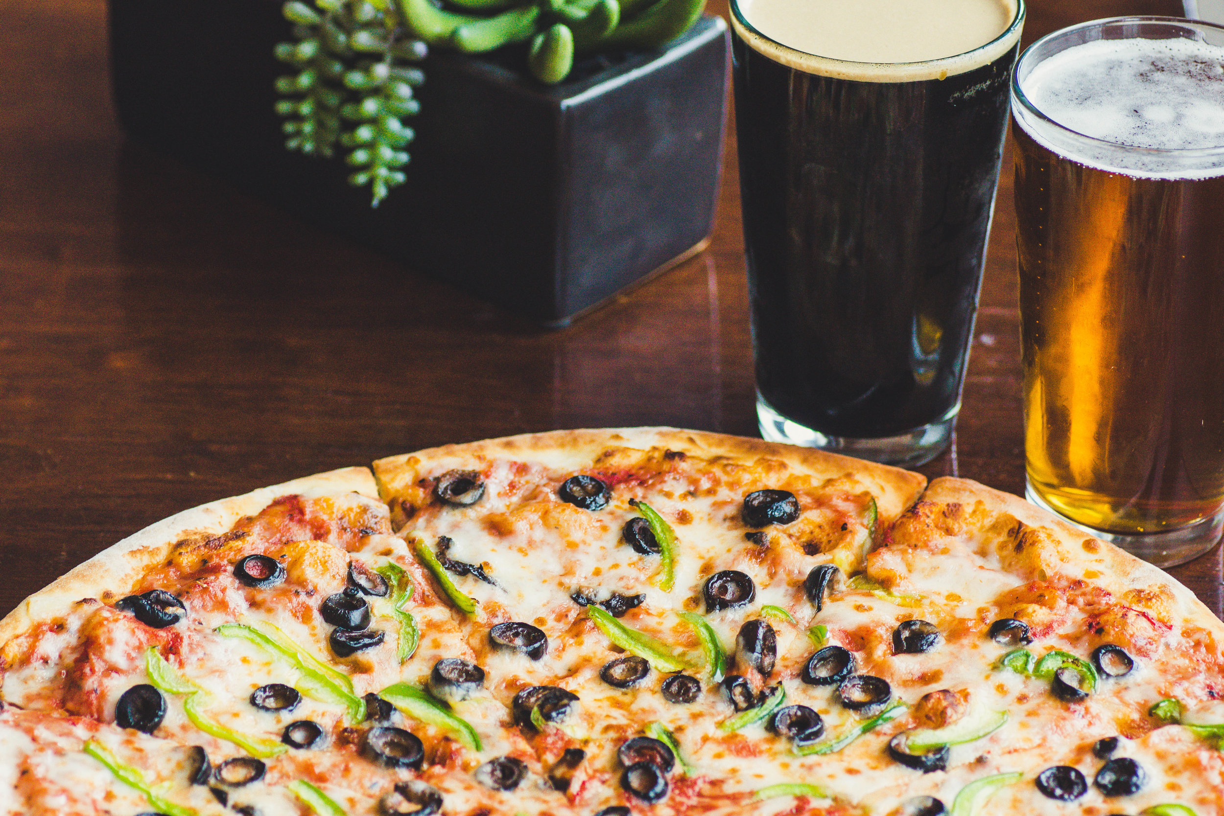 Monday Special - 1 Lrg. 2-Topping Pizza & 2 Draft Beers!  $18.95