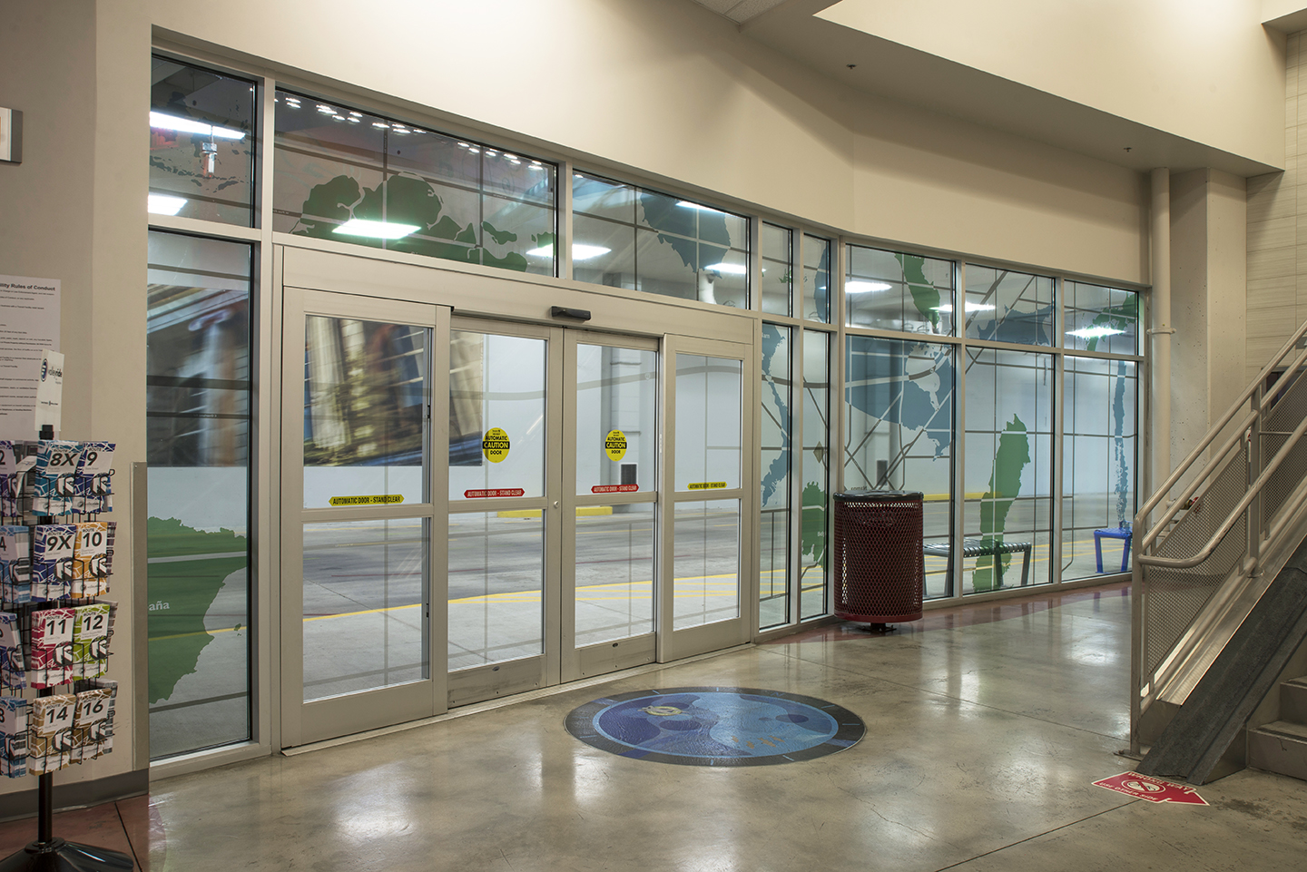 """The Commute: Idaho: Imports & Exports"" vinyl on windows, Valley Regional Transit Station, Boise, Idaho, 2018"