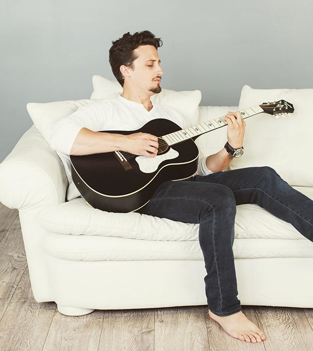 Here is where you will find me when I make some time for myself 🎸 🛋 . . There is usually a tune or a lyric that is stuck in my mind, and sometimes, I just have to stop everything, sit down at a piano or pick up a guitar and just play. 🎶  What songs would you like to hear next on one of my FB Live Concerts?? I wanna know 😉 📸: @carenaleighphotography