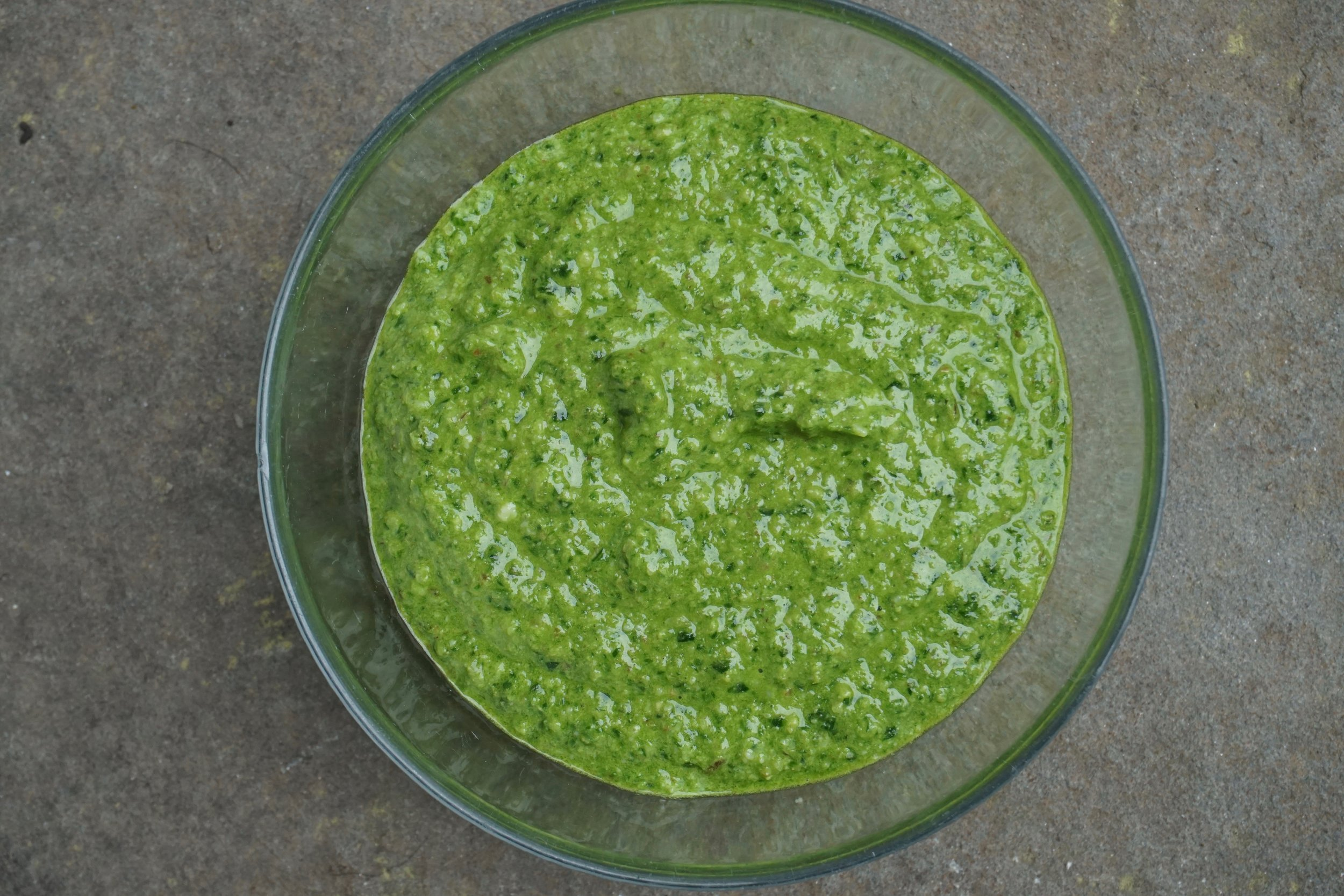 From here the pesto goes into freezer bags. Get as much air out as possible ...I roll them then seal. I use this pesto on fish, chicken, spooned into soups and of course risotto and pasta.