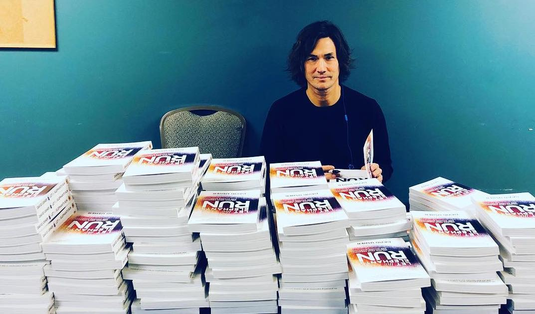 Signing books at a speaking engagement Oct, 2018