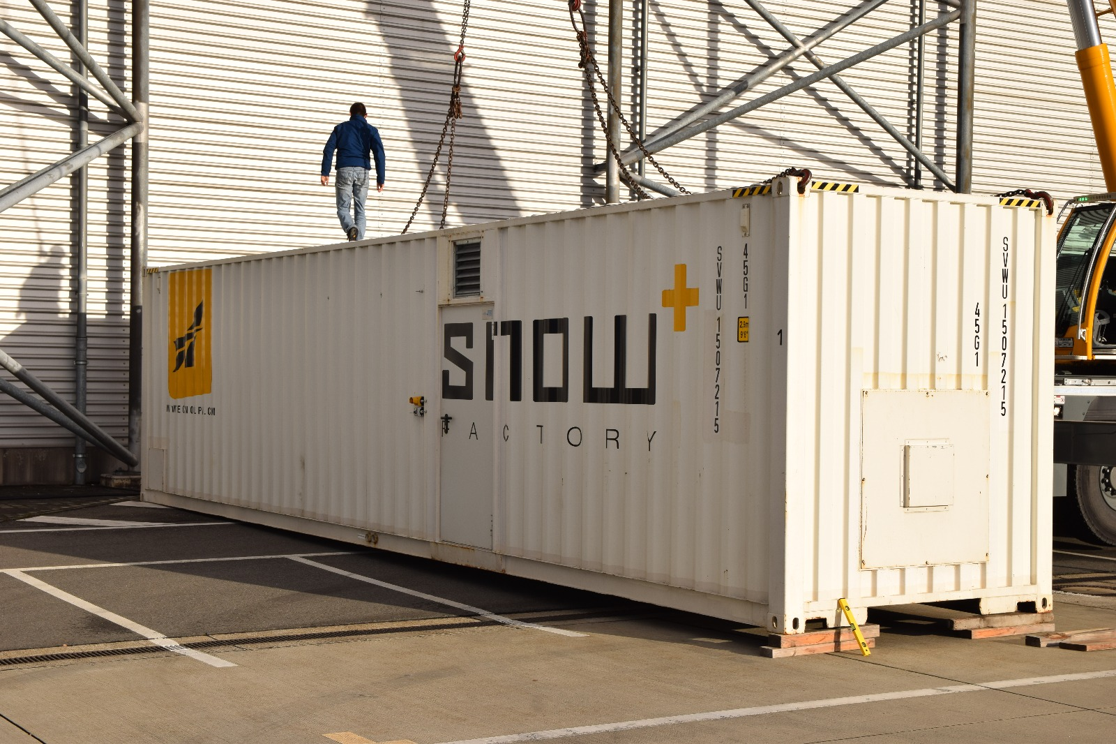 Snowmaking container set up outside a hanger at the Dresden Airport.