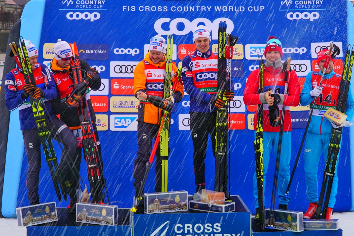 Men's team sprint podium celebrates with champagne