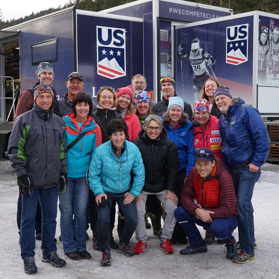 "Guests on the inaugural Lumi Experiences ""Trip to Tyrol"" helping to benefit the National Nordic Foundation, after taking a tour of the US Ski Team wax truck with coach Matt Whitcomb."