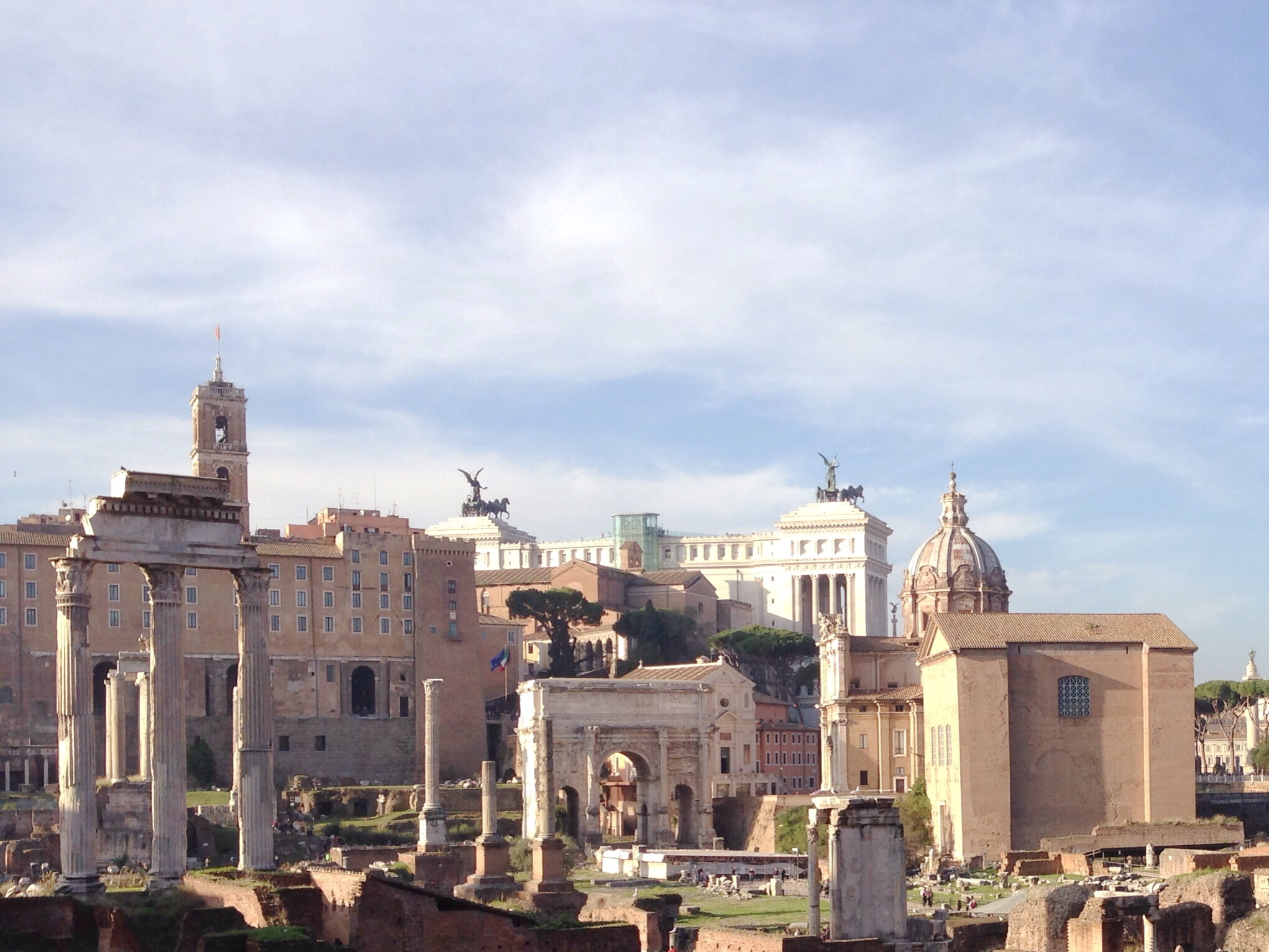 Views of the temple of Castor and Pollux, hearth of the Vestal Virgins, and Arch of Septimius Severus in the Roman Forum in Rome, Italy.