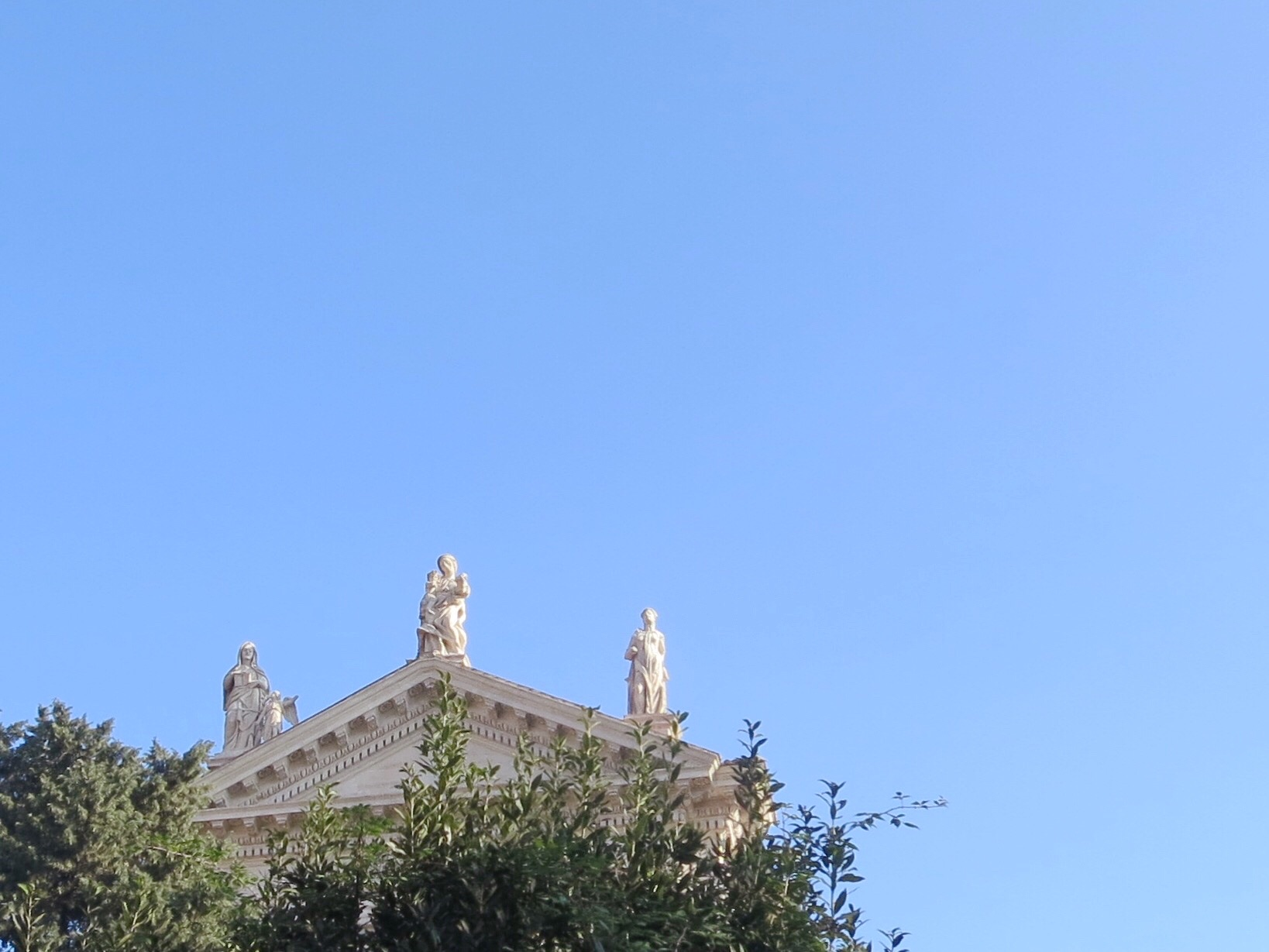 Statues atop a temple in the Roman Forum in Rome, Italy.