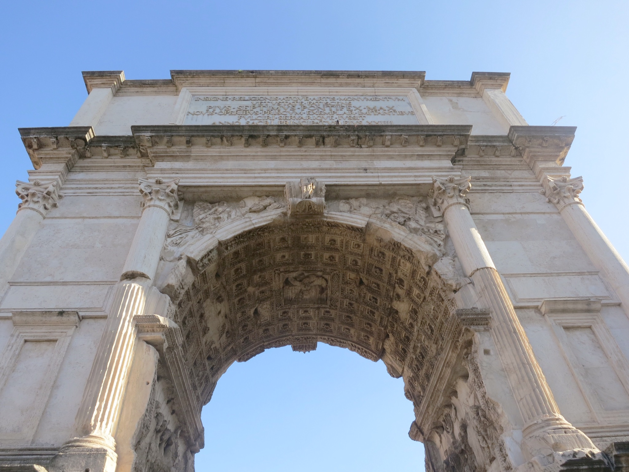 The Arch of Titus has detailed relief inside depicting the spoils of Jerusalem. Roman Forum, Rome, Italy.