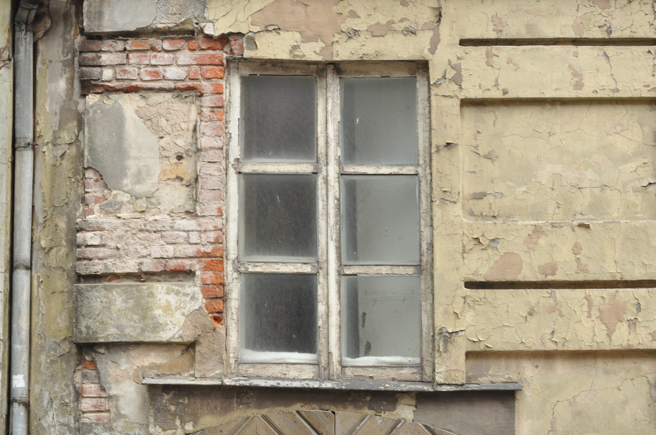 Crumbling brick and window in Riga, Latvia