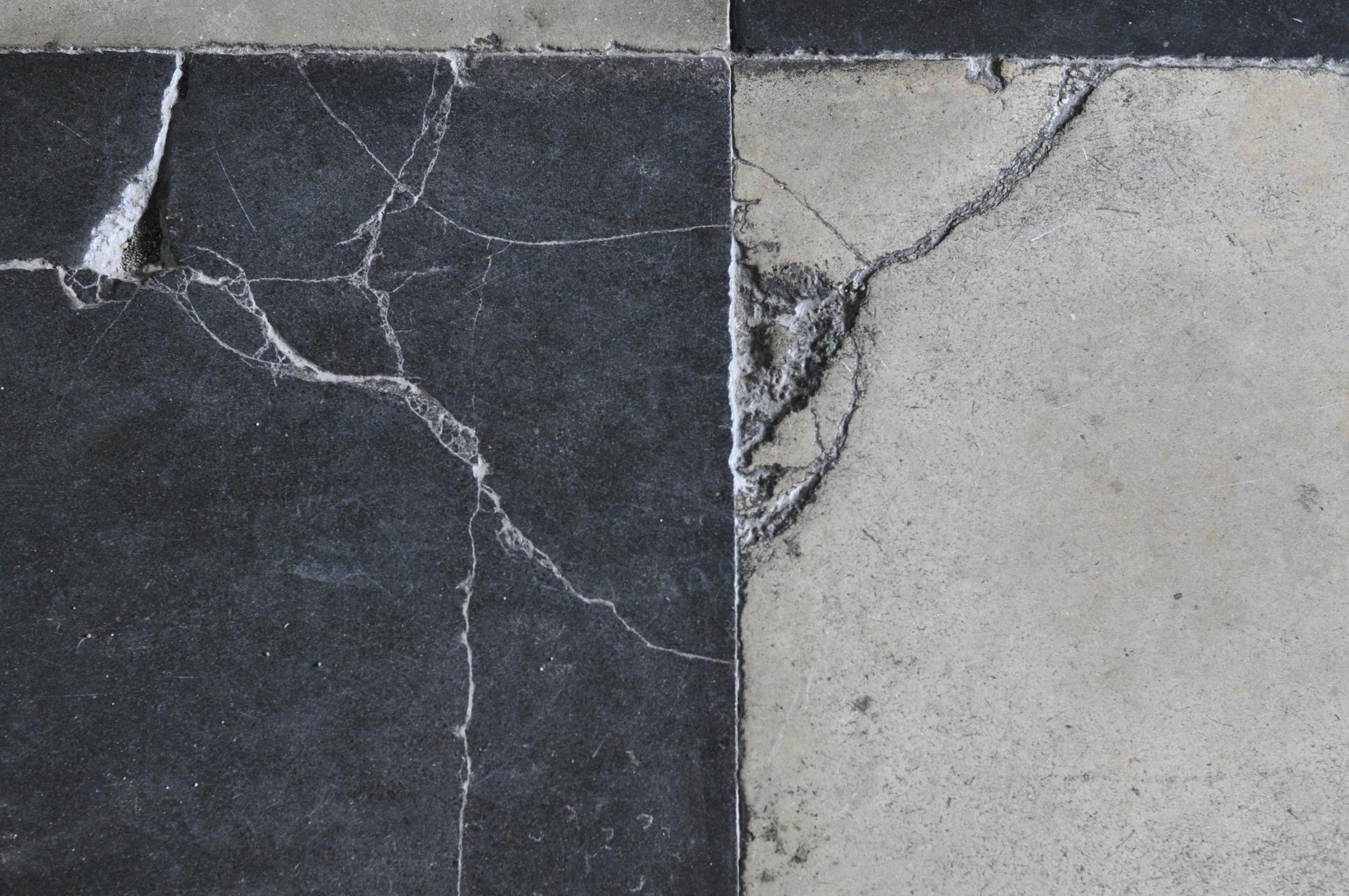 Cracked floor tiles in San Agustin Church, Intramuros, Manila Philippines