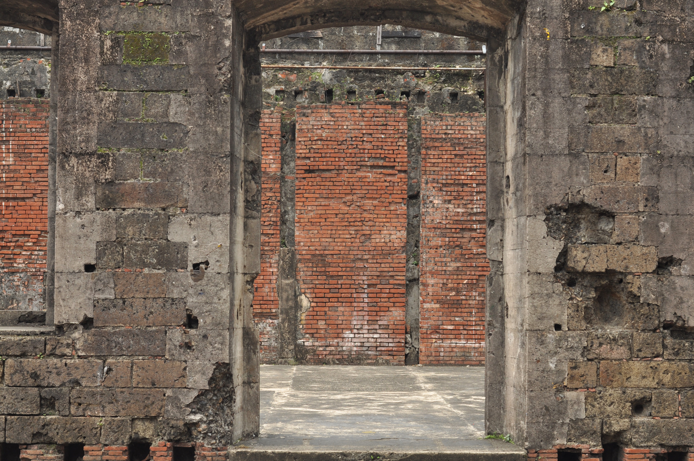 Stone wall leading into remains of buildings in Fort Santiago Intramuros, Manila, Philippines