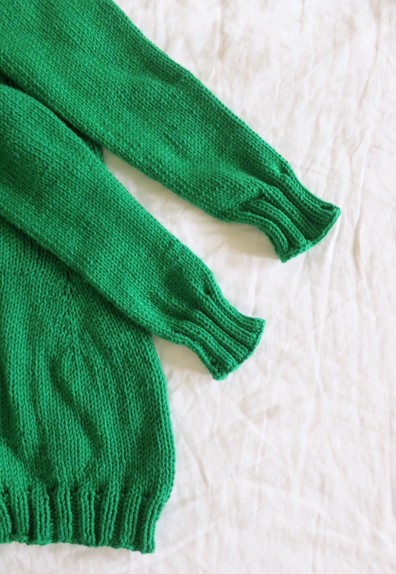 Green knit cardigan in progress