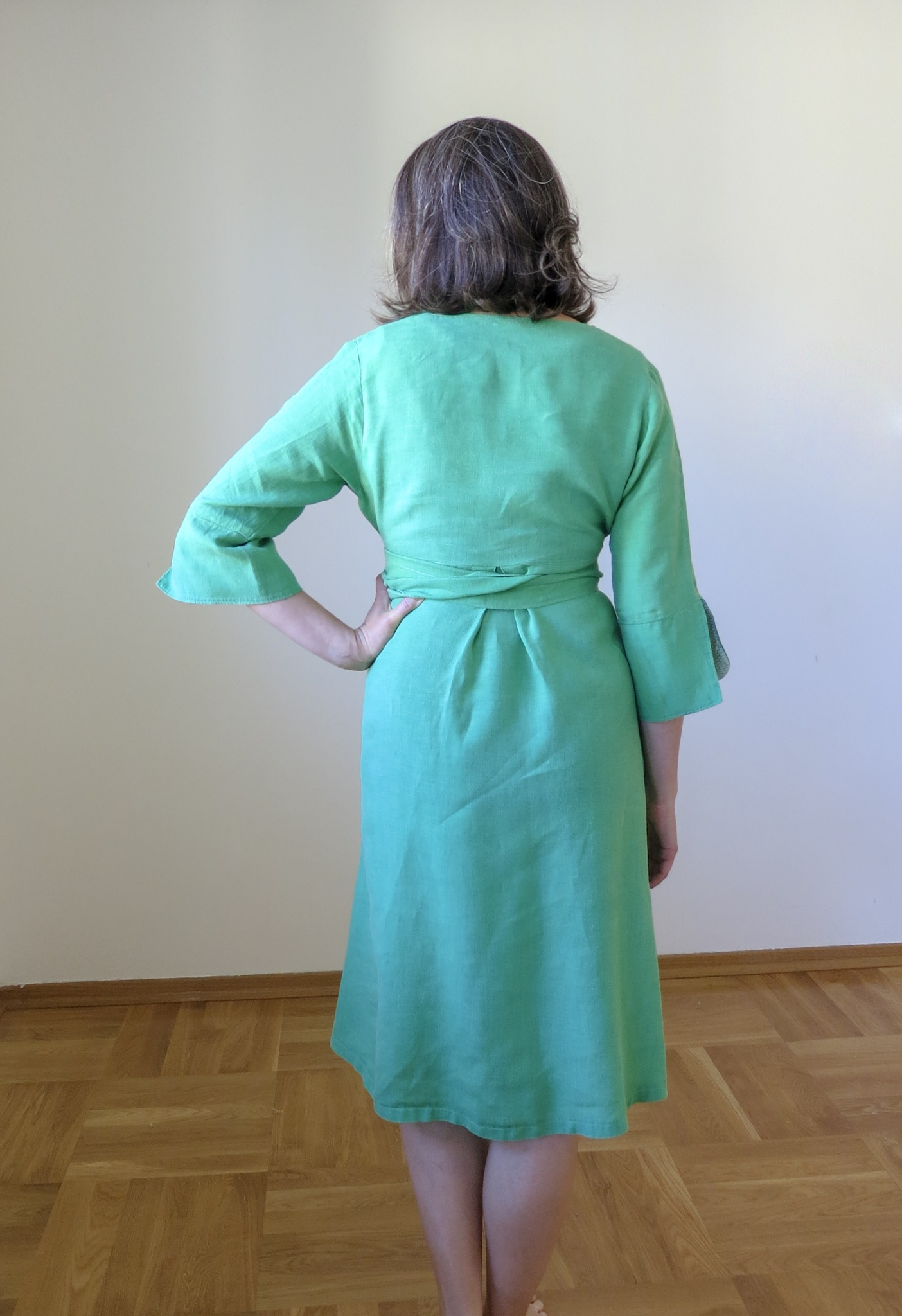 Green linen Schoolhouse Tunic Dress hack, back view