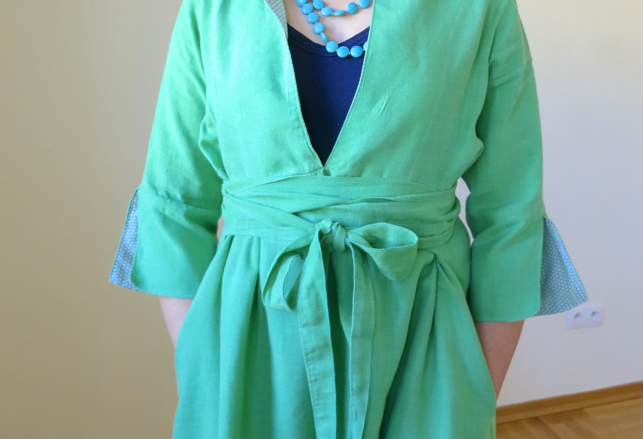 Tie detail on a green linen Schoolhouse Tunic dress