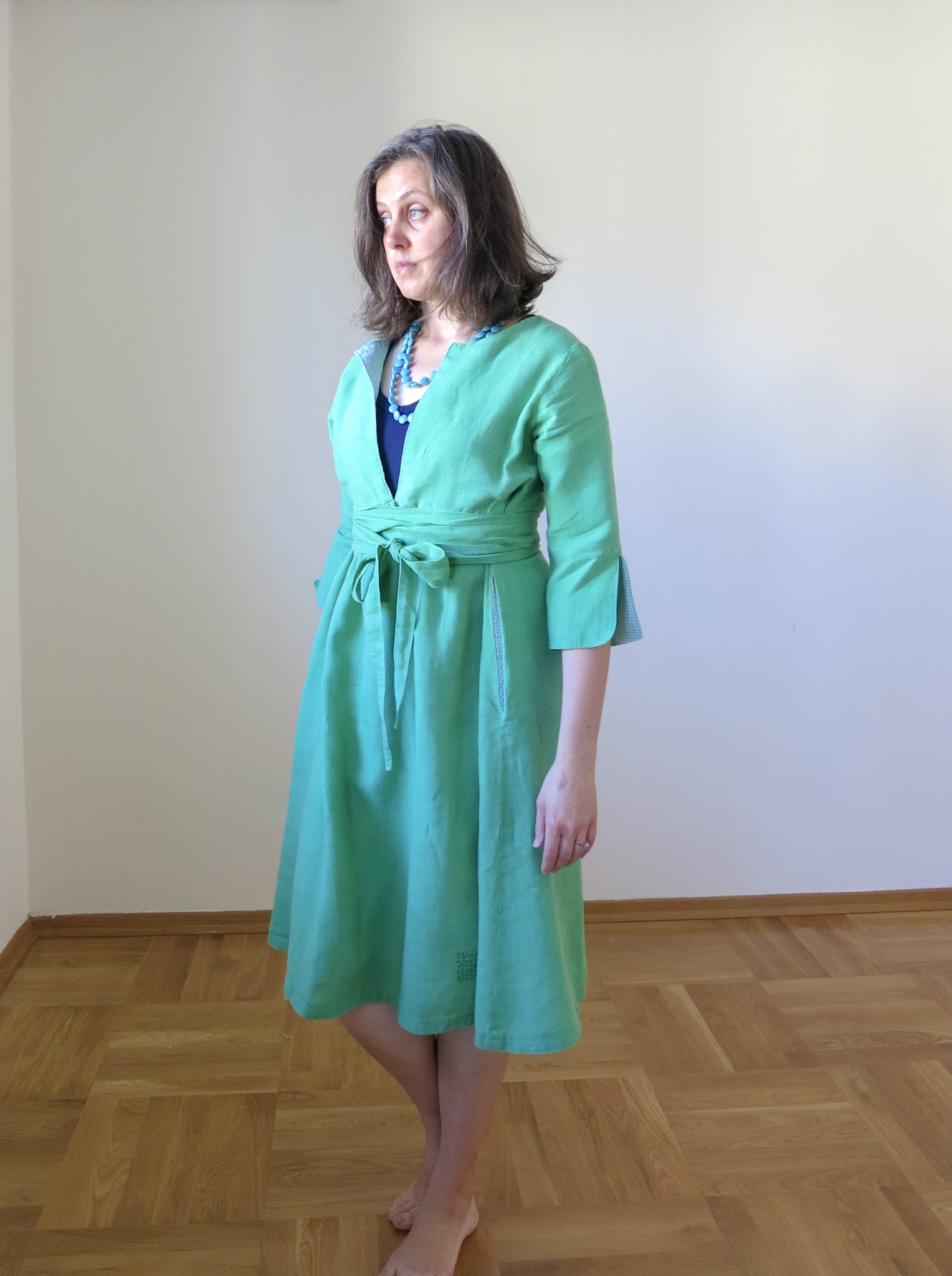 Green linen Schoolhouse Tunic Dress hack, front view
