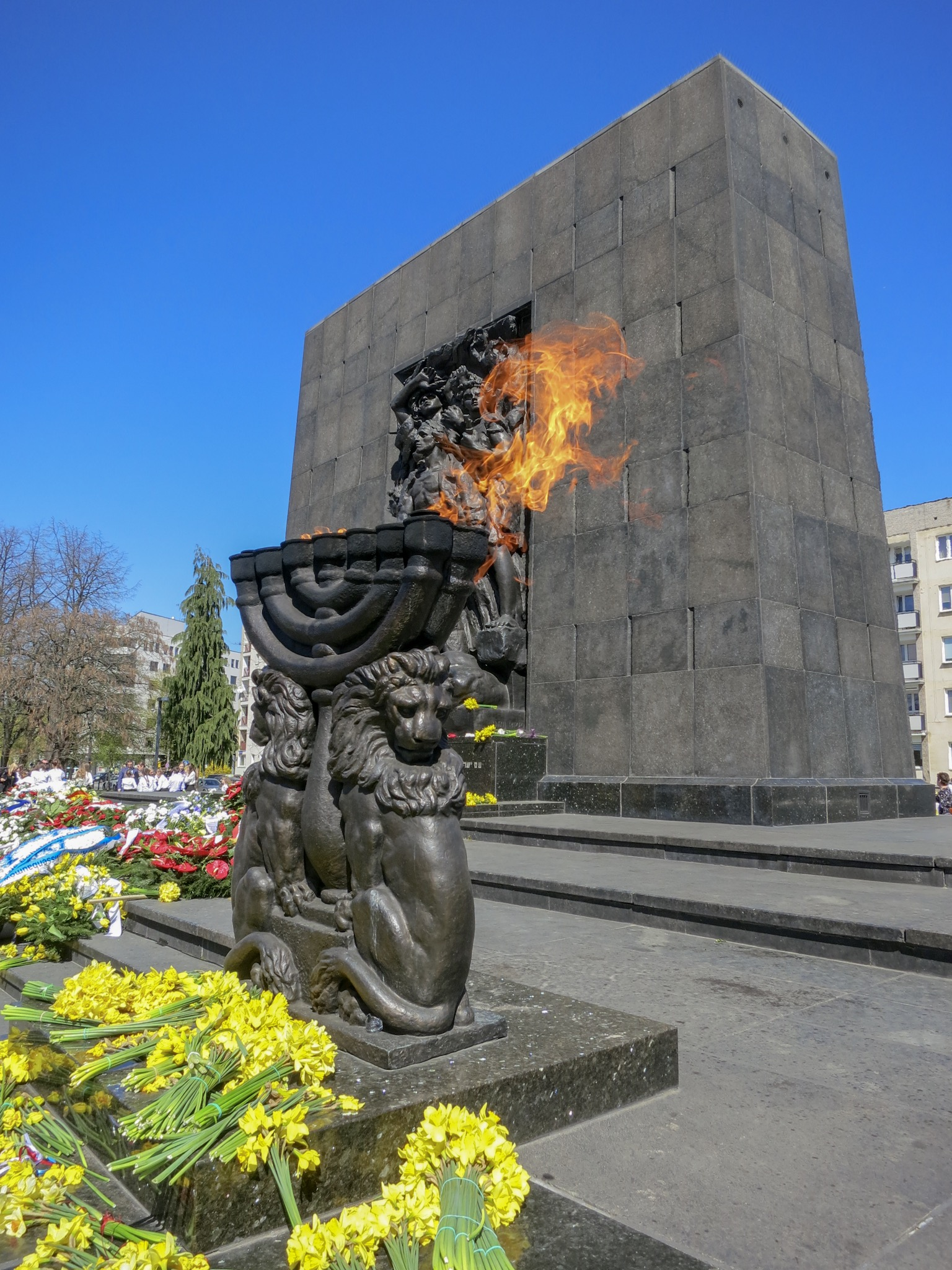 The menorah is lit on the Heroes of the Ghetto Monument in commemoration of the 76th Anniversary of the Warsaw Ghetto Uprising