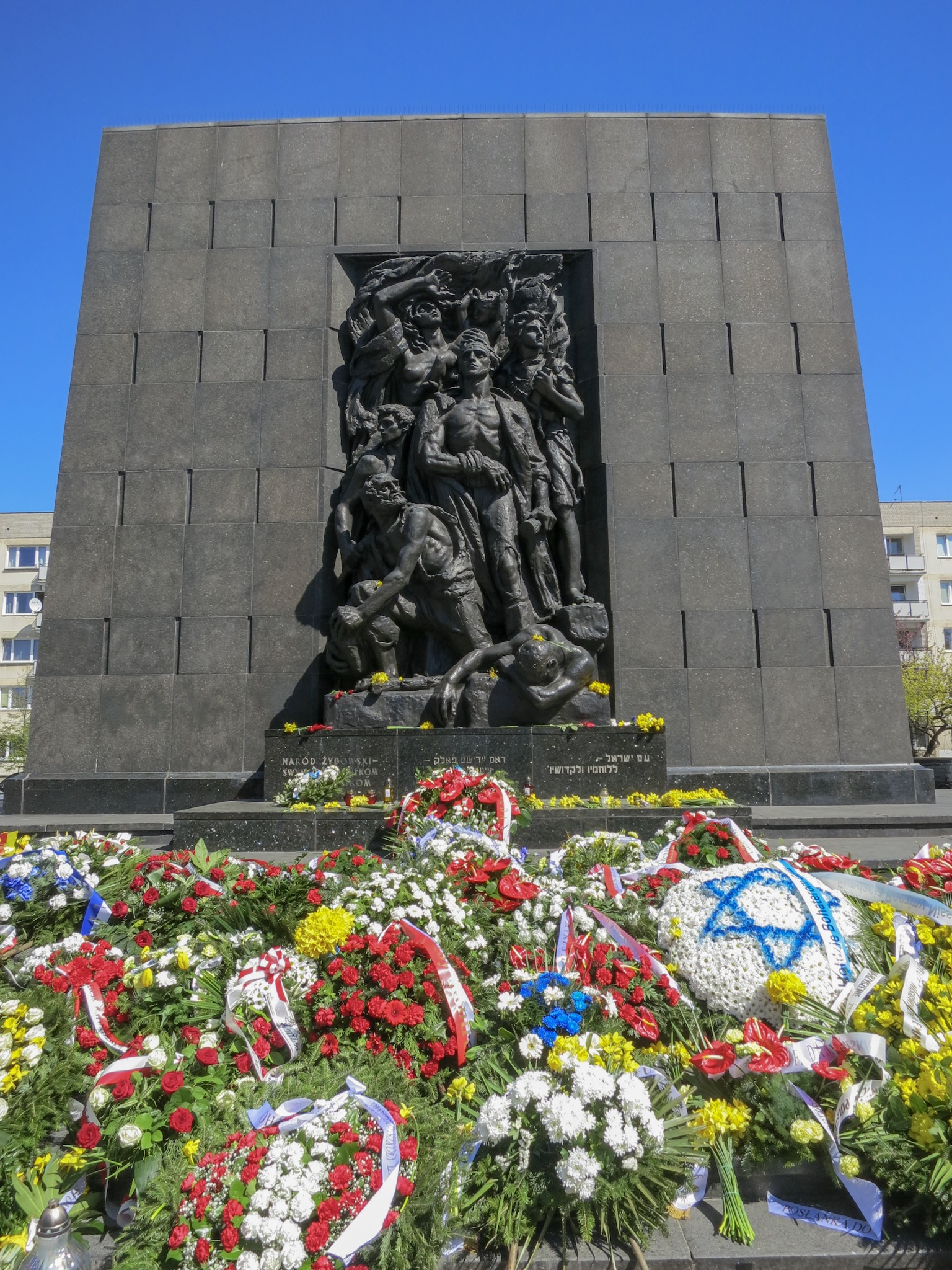 Heroes of the Ghetto Monument covered in wreaths and flowers in commemoration of the 76th Anniversary of the Warsaw Ghetto Uprising