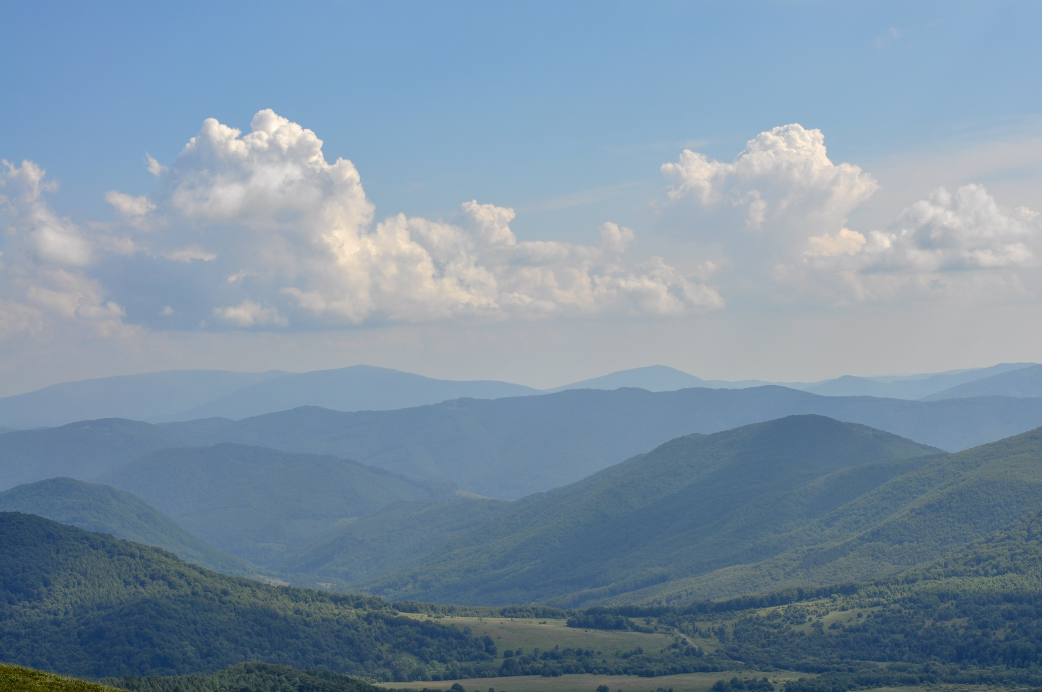 Green and blue mountain ranges in the Bieszczady National Park