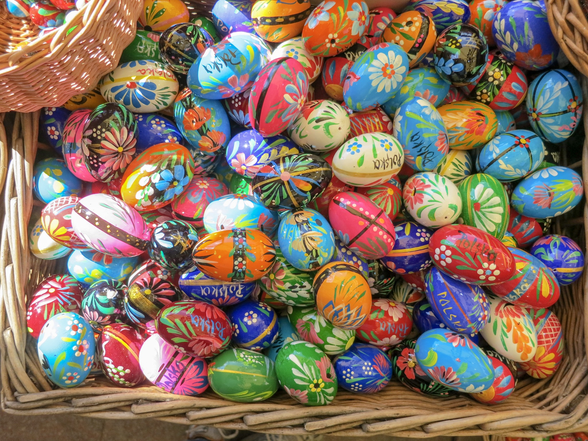 Wooden eggs painted with folkart and the word Polska