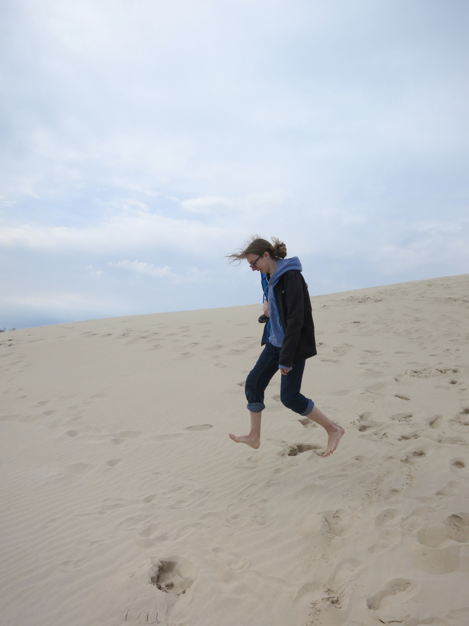 Jumping above the sands on the Łackca Sand Dune In Słowiński National Park