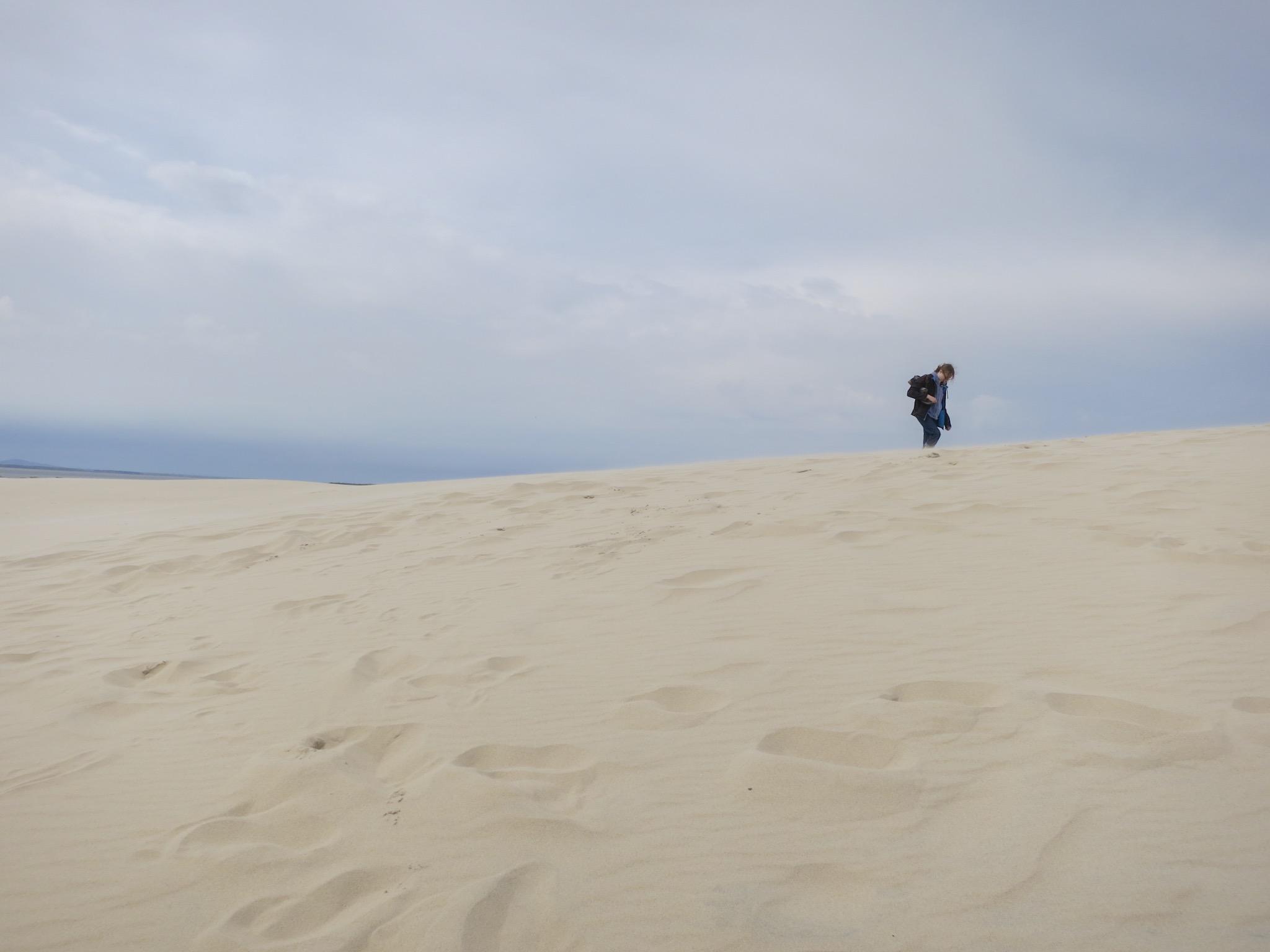 A walker on the Łackca Sand Dune In Słowiński National Park