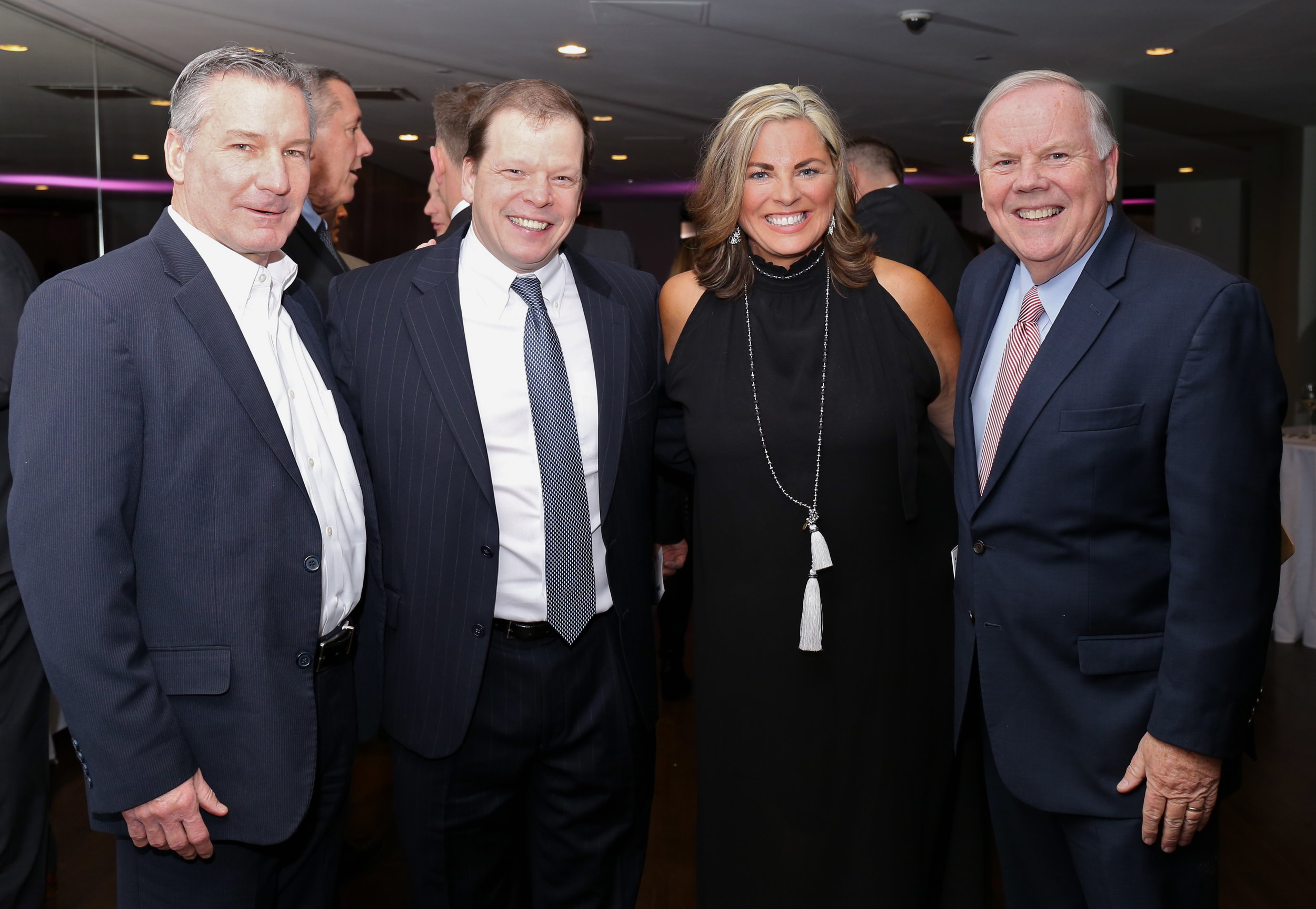 President & CEO of the Boys and Girls Clubs of Dorchester Bob Scannell, Chef Paul Wahlberg, Jett Foundation Founder Christine McSherry, and Boston photographer Bill Brett.